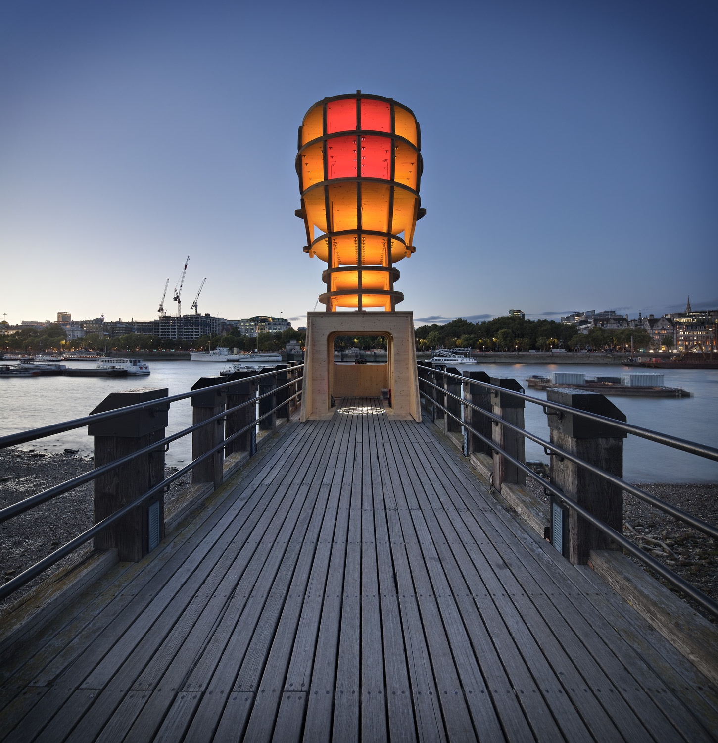 """Light sculpture, """"Head Above Water"""" by Steuart Padwick on the Oxo Tower pier, South Bank, London. Interactive lighting installation by Hoare Lea Lighting. The sculpture supports Time to Change's campaign to remove the stigma of mental illness."""