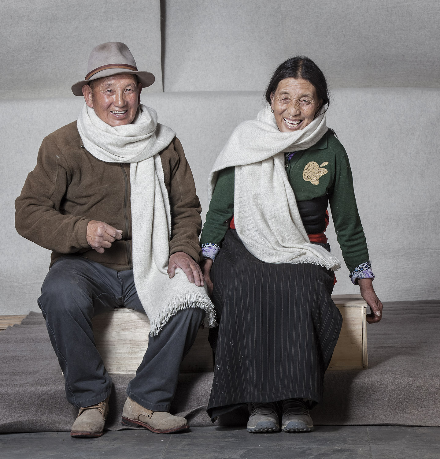 Husband and wife modelling shawls, Norlha Factory, Ritoma, Amdo, Tibet