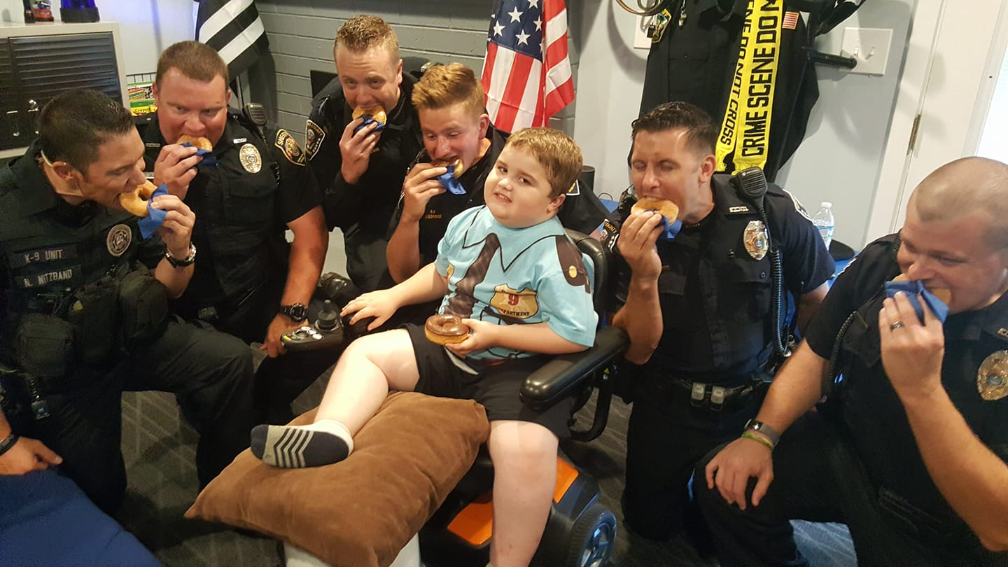 Peyton Eats Donut with Officers.jpg