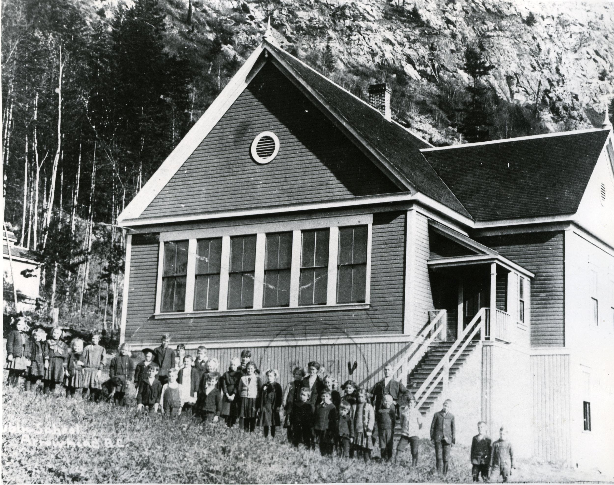 Arrowhead School with teacher J.R. Thompson next to the stairs, circa 1910. P1995