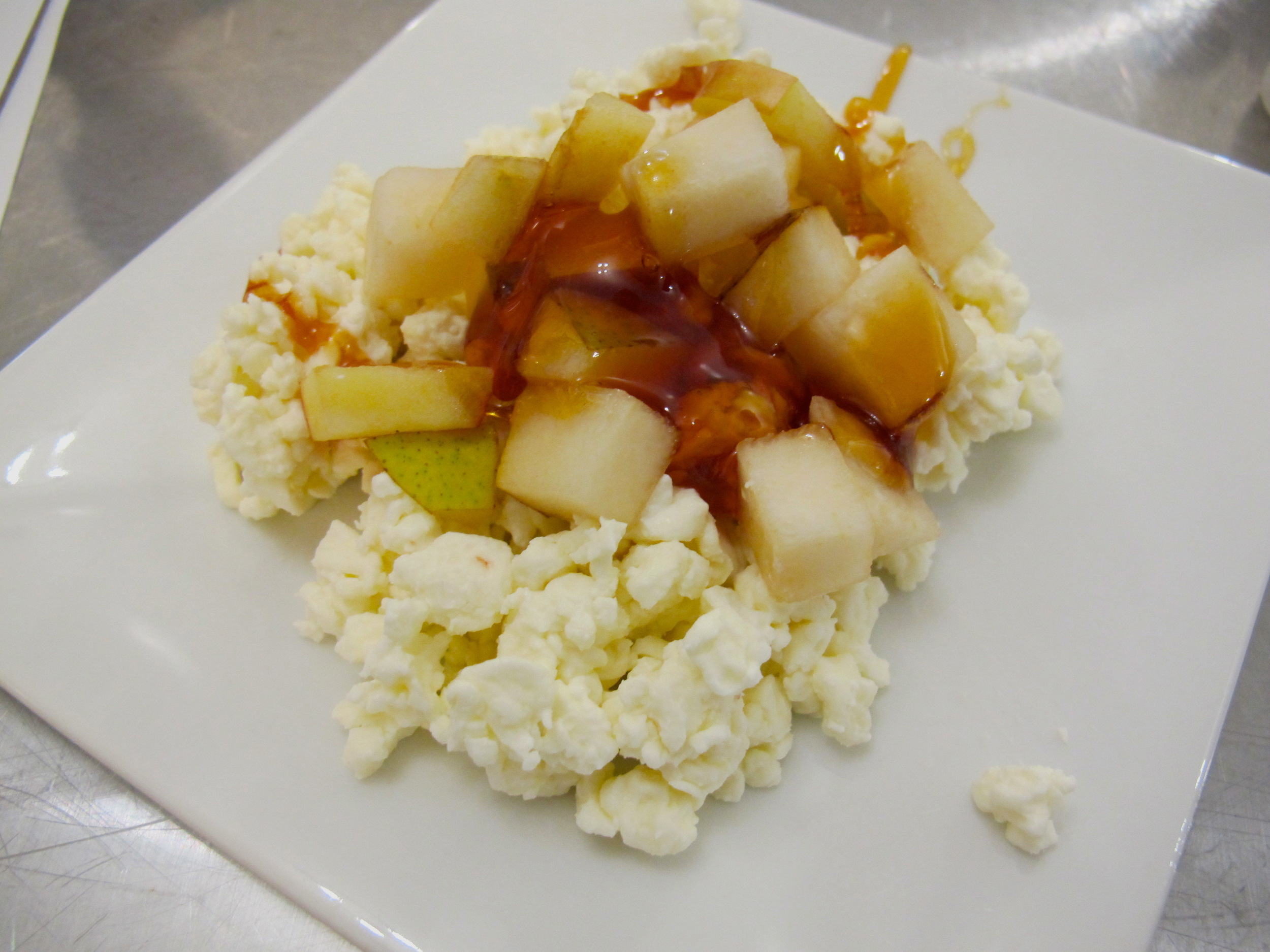 Homemade cottage cheese with apple and honey