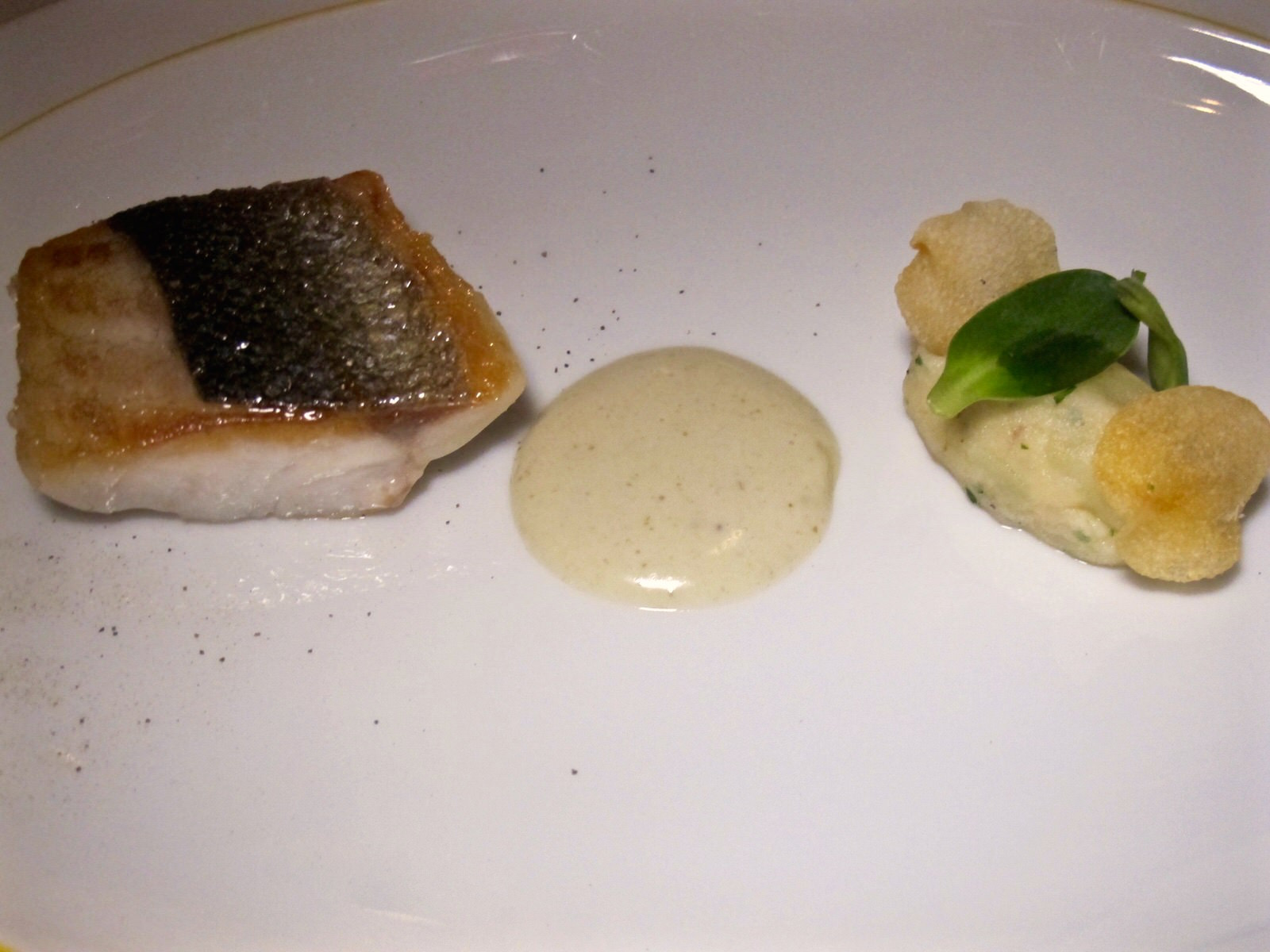 Sauteed fillet of Mediterranean loup de mer, fork crushed la ratte potatoes, garden sunflower sprouts and Spanish caper emulsion