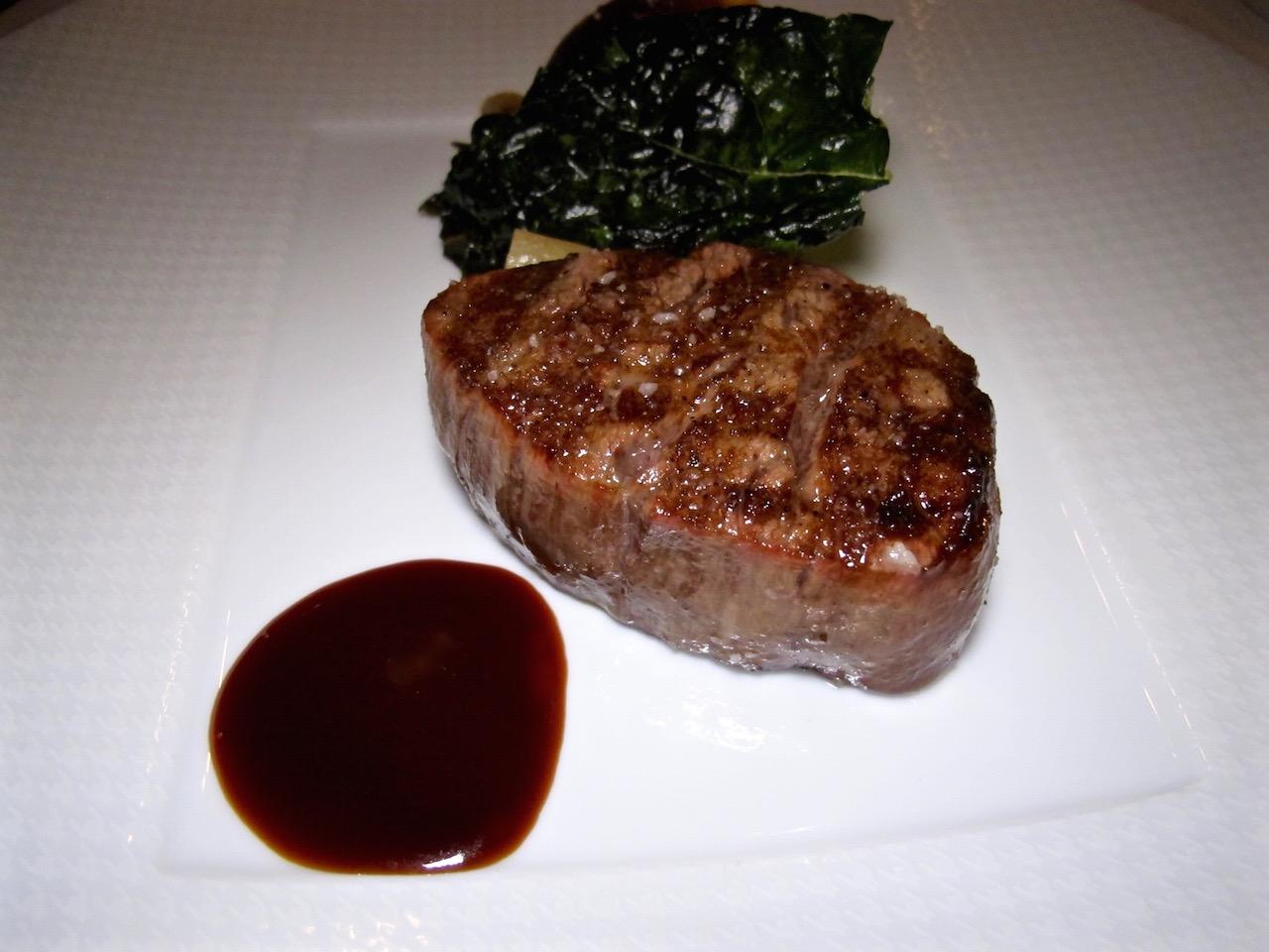 Charcoal grilled Japanese Wagyu, ris de veau dumpling, braised collard greens, garden salsify and sauce bordelaise