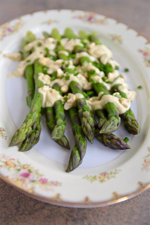 Poached asparagus with Vegan Cauliflower Cashew Cream | TastingPage.com