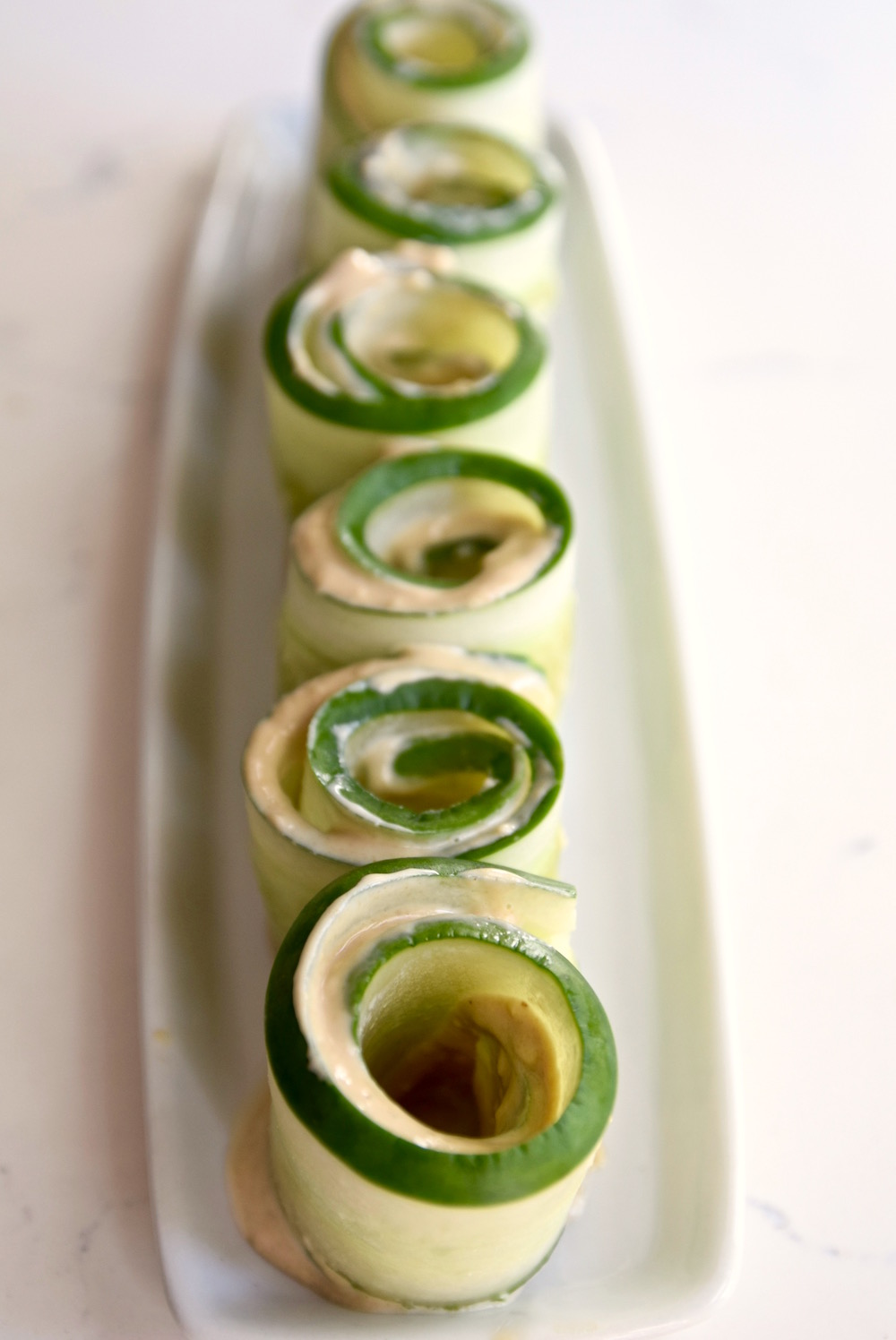Sunflower Tahini Cucumber Roll Ups - a great gluten free, dairy free and nut tree after school snack   TastingPage.com