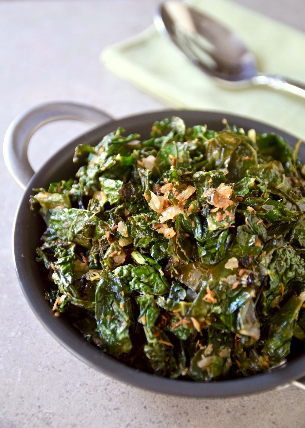 An easy weekday side comes together quickly with this tropical sauteed coconut lime kale - gluten free and dairy free | TastingPage.com