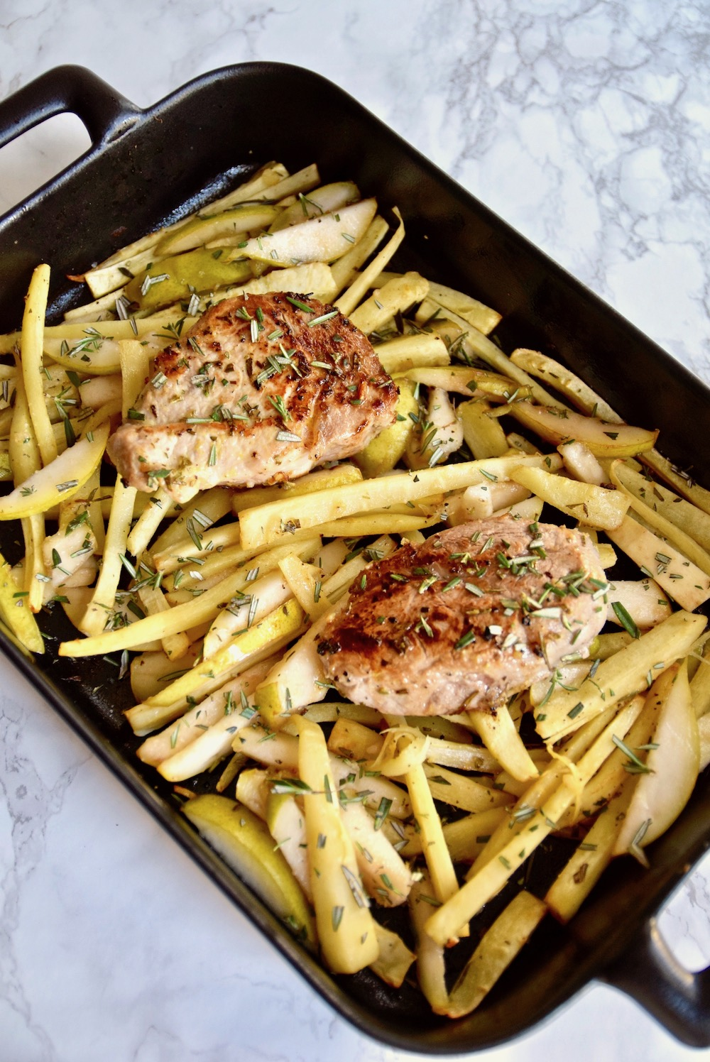 Rosemary Pork with Roasted Parsnips and Pear - gluten free and dairy free and perfect to serve for a holiday dinner | TastingPage.com
