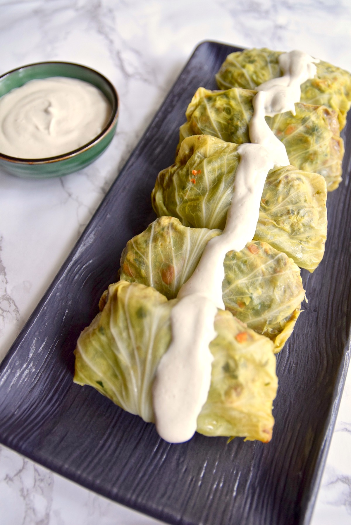 This tomato-less stuffed cabbage with cashew cream is great for St. Patrick's Day or any day of the year. It's dairy free, rice free and night shade free so great for AIP Paleo or a healthy meal | TastingPage.com