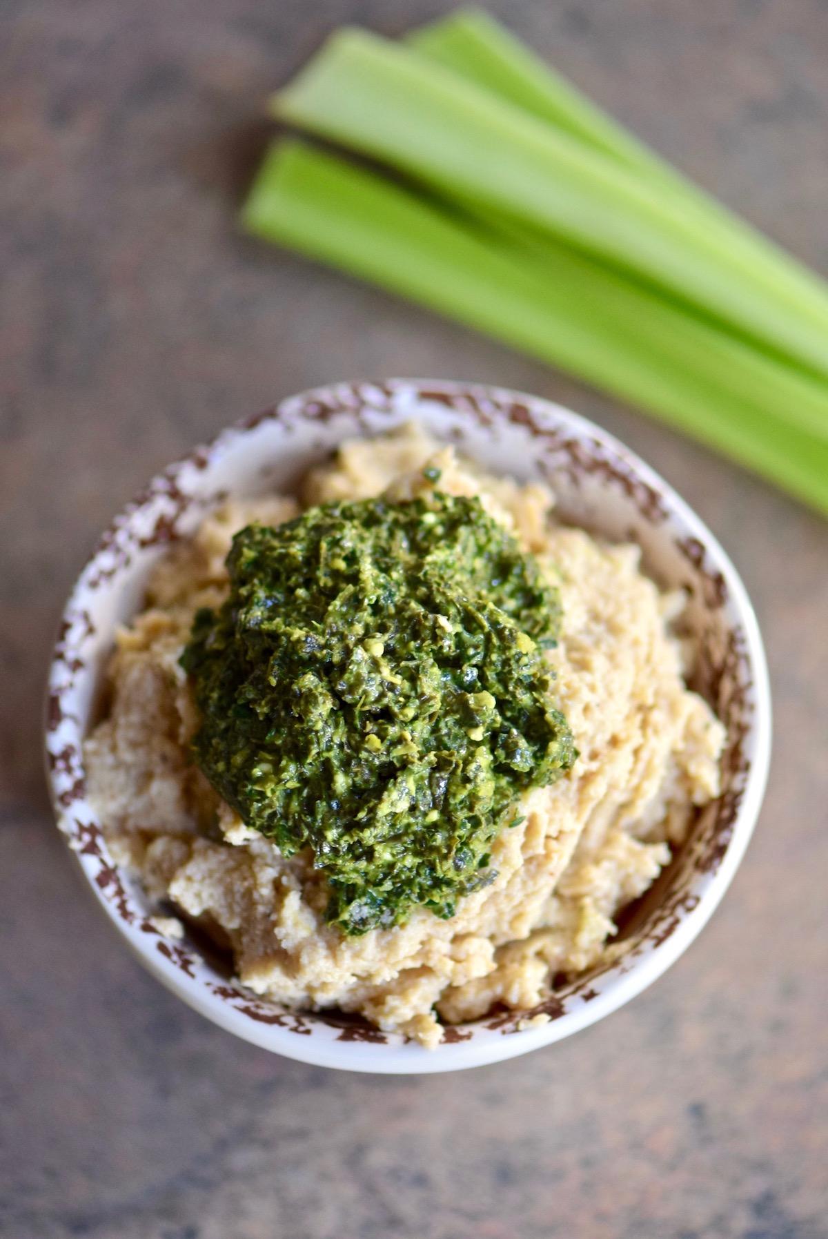 Cauliflower Hummus with Kale Pesto - double down on your veggies with this beanless hummus that's paleo and vegan   TastingPage.com