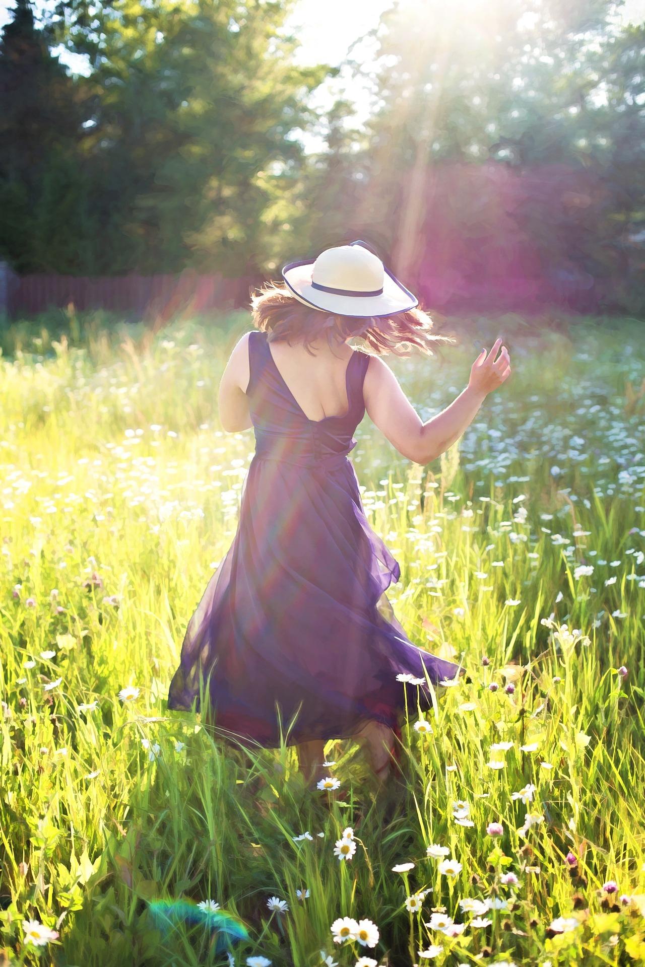pretty-woman-dancing-in-field