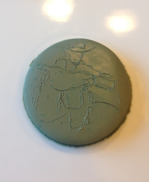 The first medallion just started, which I later scrapped as I re-did it in Sculpey so I could bake it.