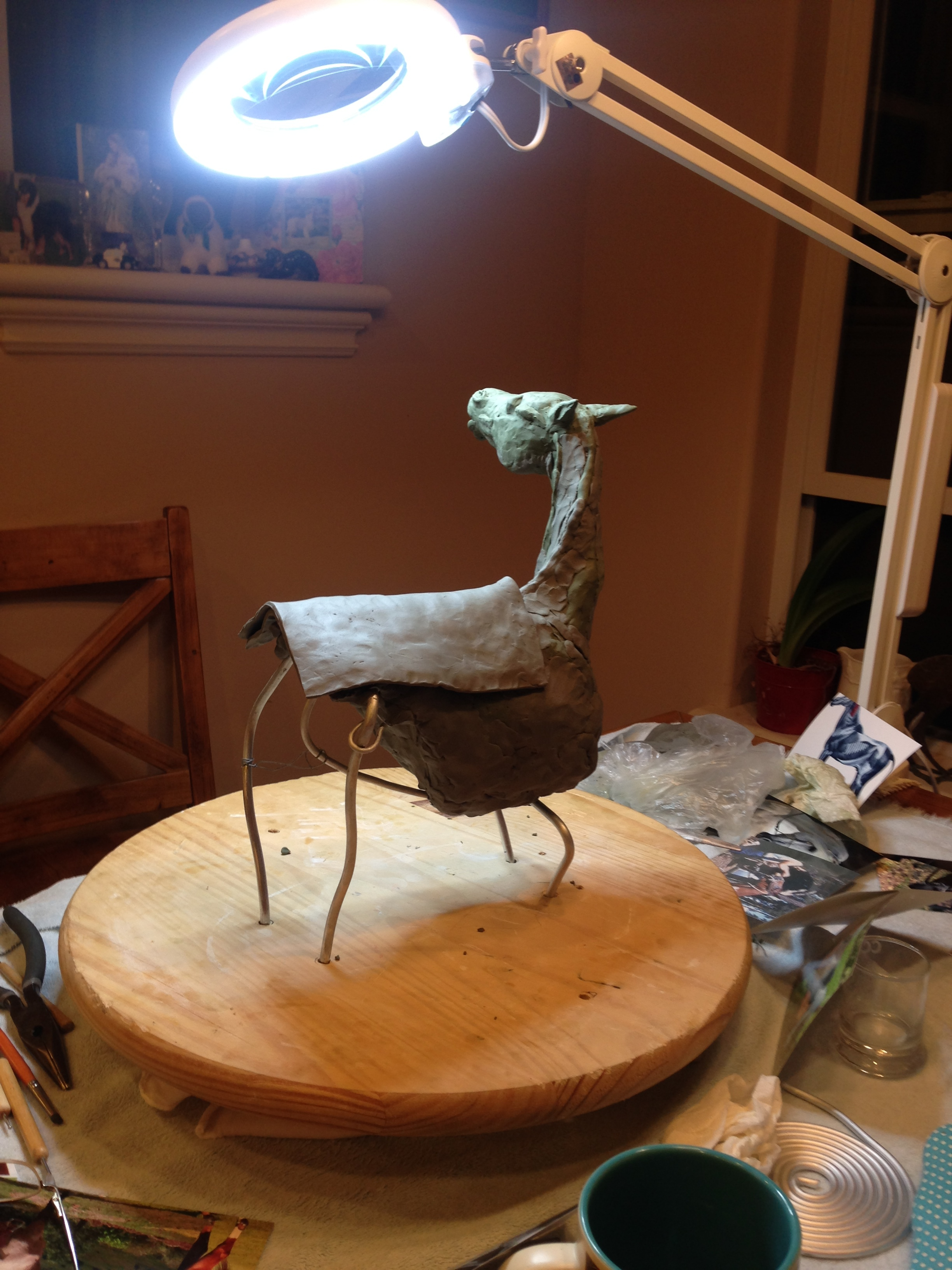 Figuring out the saddle blanket and also how the sculpture would be designed. I wanted the detail there, but when someone looked from another angle they would see pleasing lines. The underside was a work in progress.