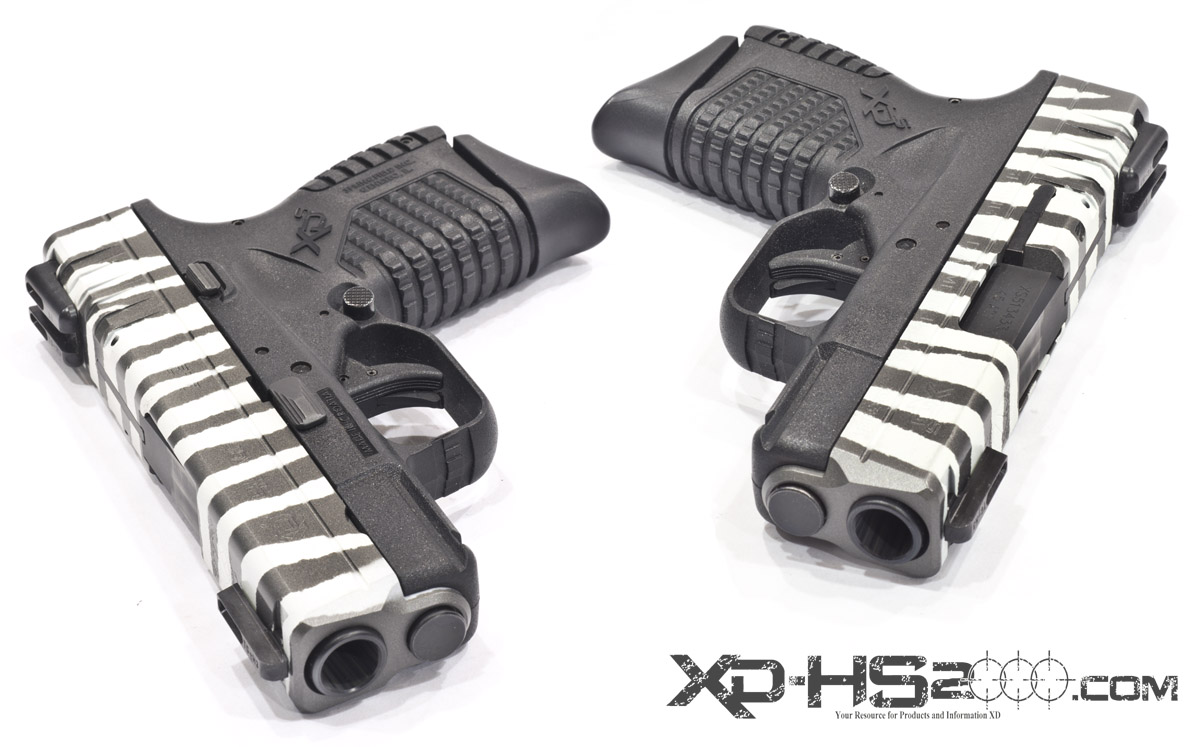 White and Titanium tiger striped Springfield Armory XDS pistol.