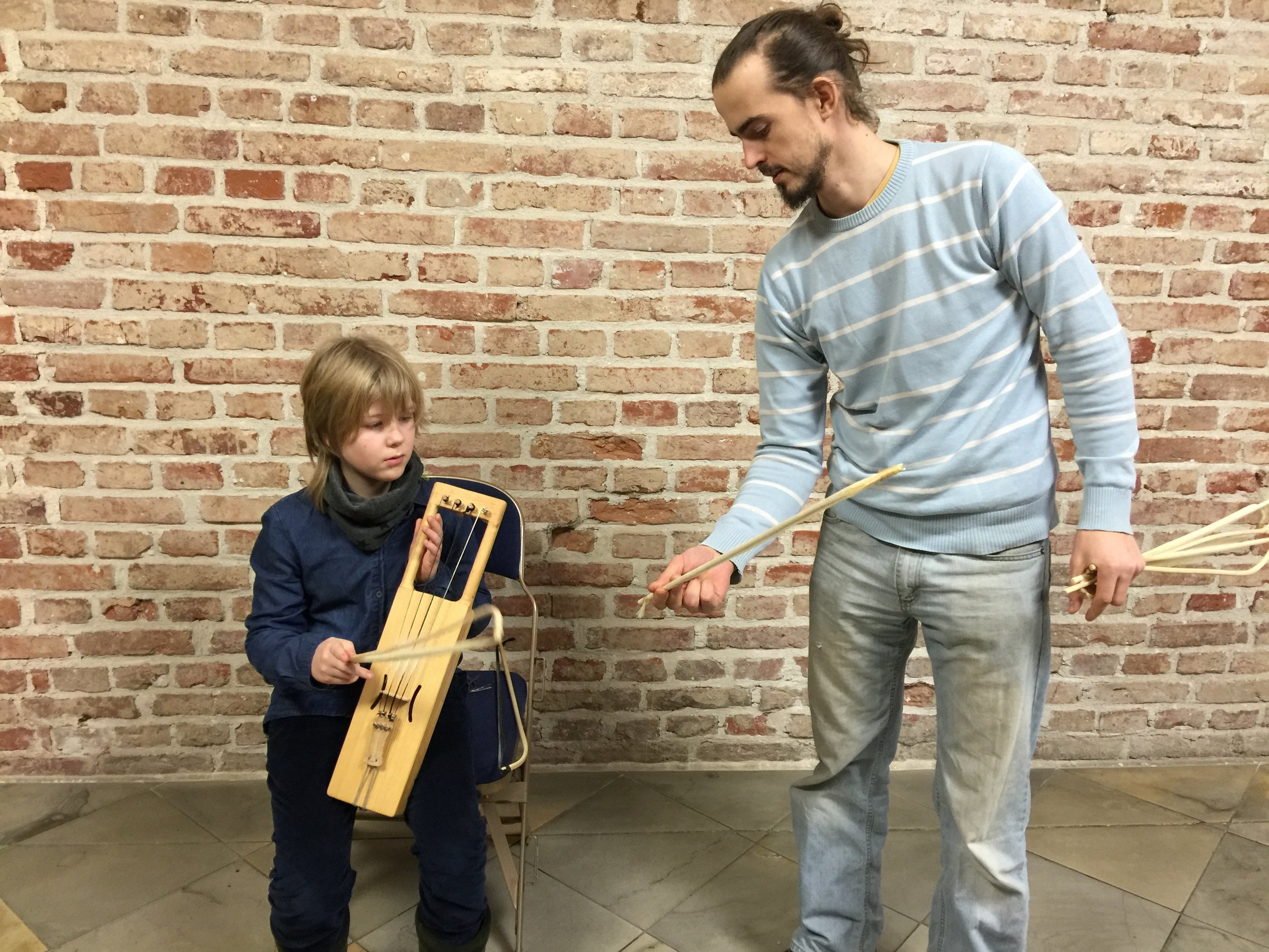 The new harp with its maker Mihkel Soon and my son.