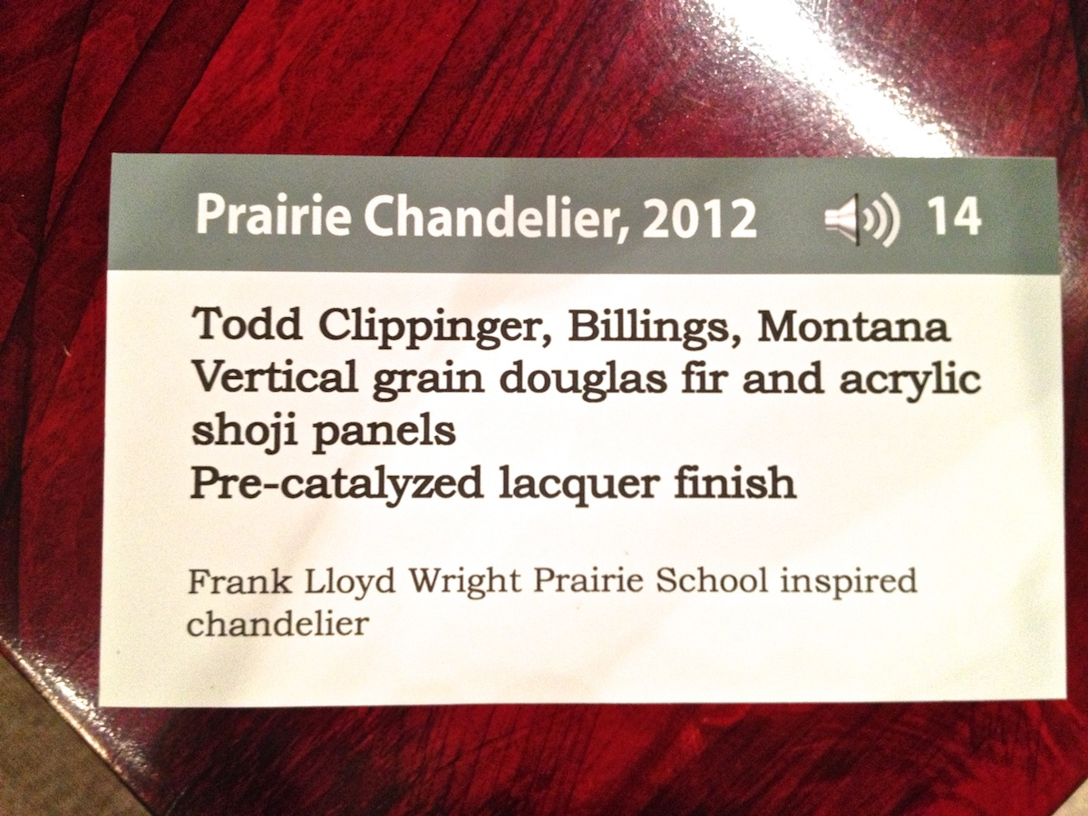 Official gallery tag for the prairie chandelier on display in the Museum of the Rockies fine woodworking exhibition.