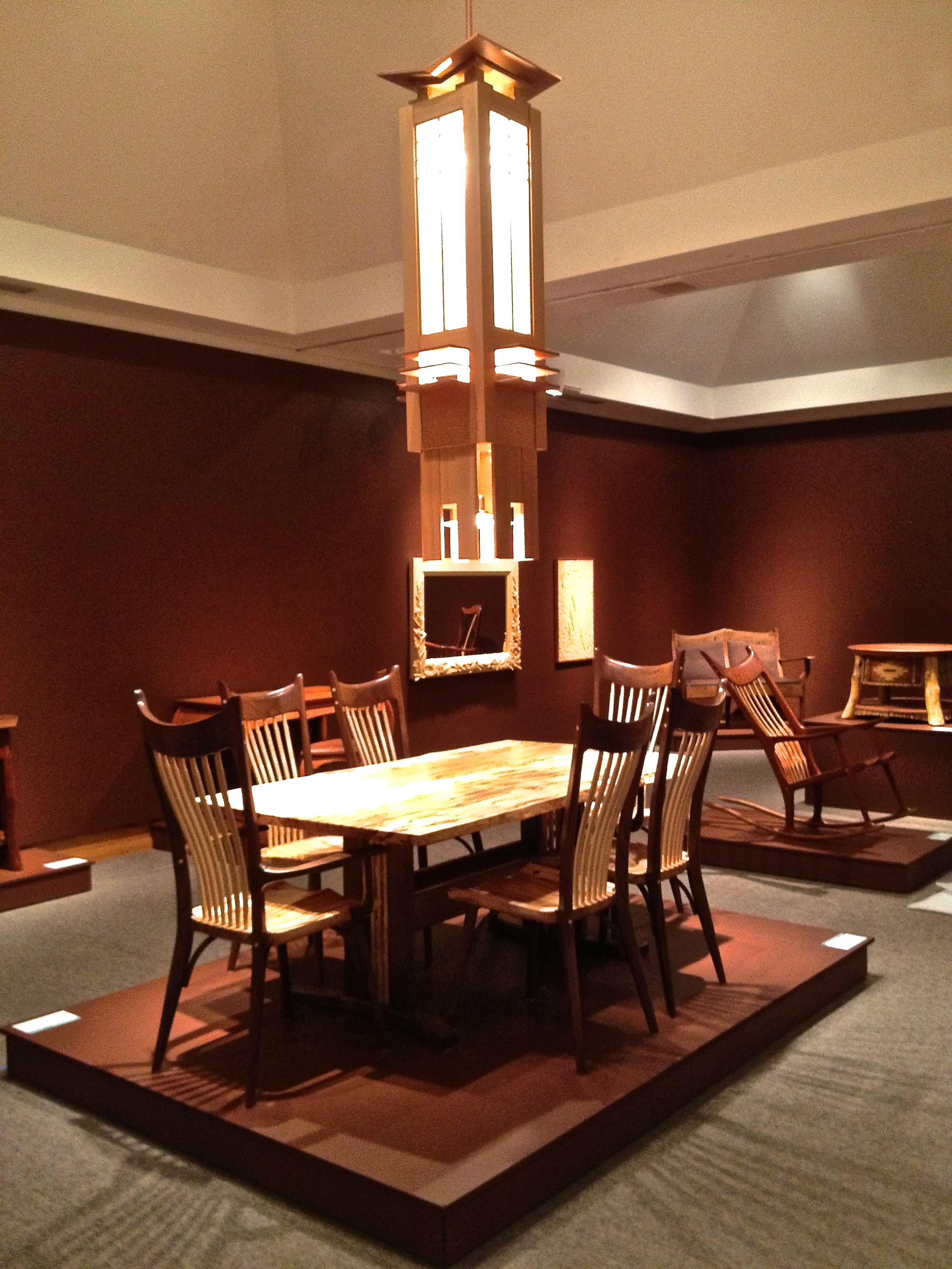 The Frank Lloyd Wright inspired prairie chandelier on display in the Museum of the Rockies fine woodworking exhibition. It hangs over the dining table and chairs of furniture maker Tim Carney of Helena, Montana.