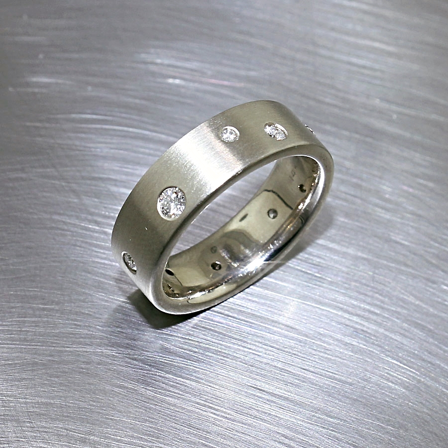 Style #21110040: Glittering Flush-Set Diamond Band in Matte-Finished White Gold