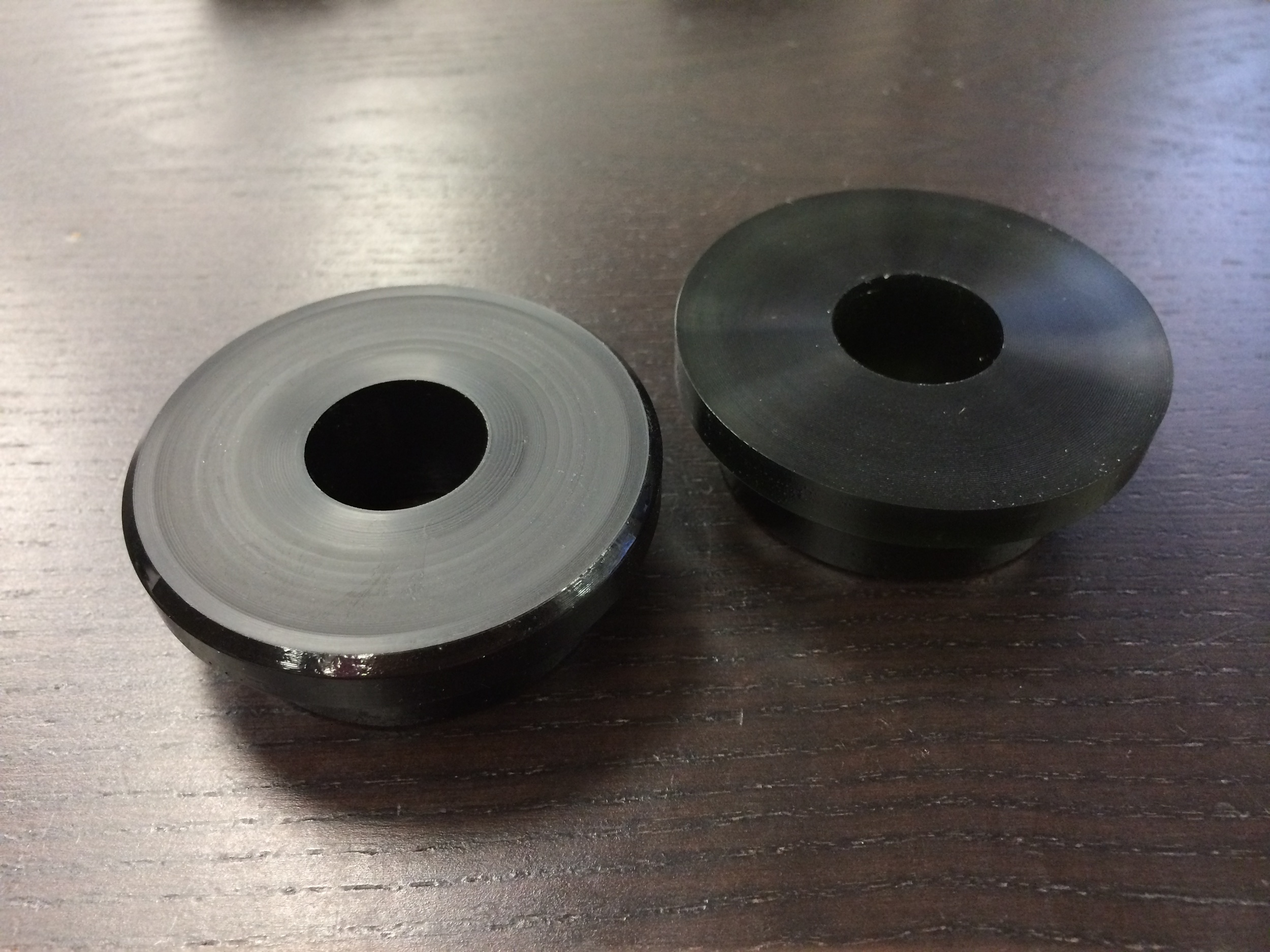 COMPARISON: On the left, the new Class 1 Street Urethane for the Torq R3. The new compound is opaque and has a chamfered flange.  On the right, the previous Street Urethane for the Torq R3. The discontinued bushings are slightly translucent.
