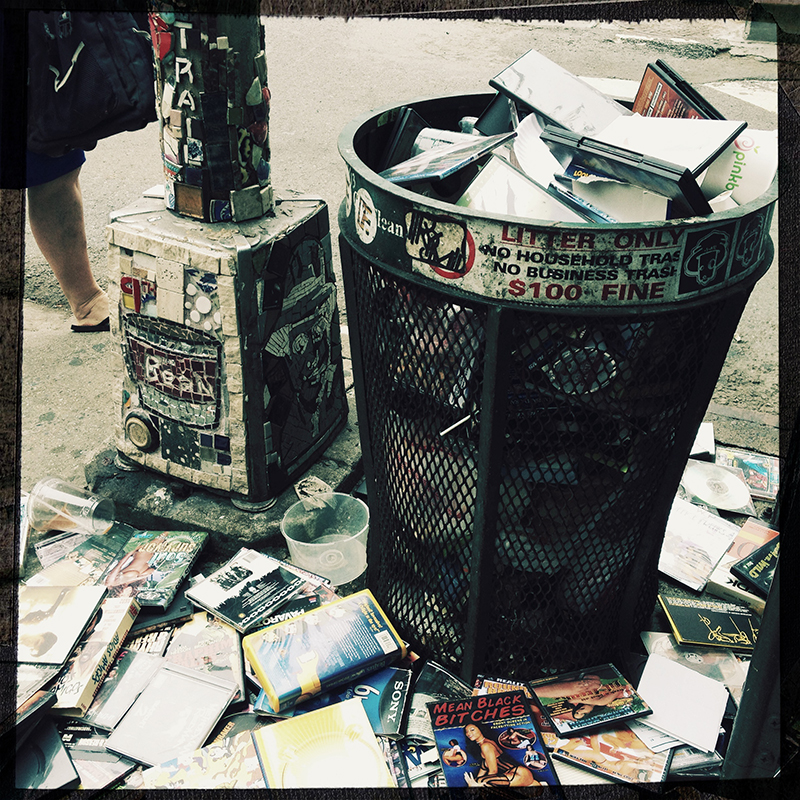 Trash 2 - NYC A trash can filled with pornographic DVDs.