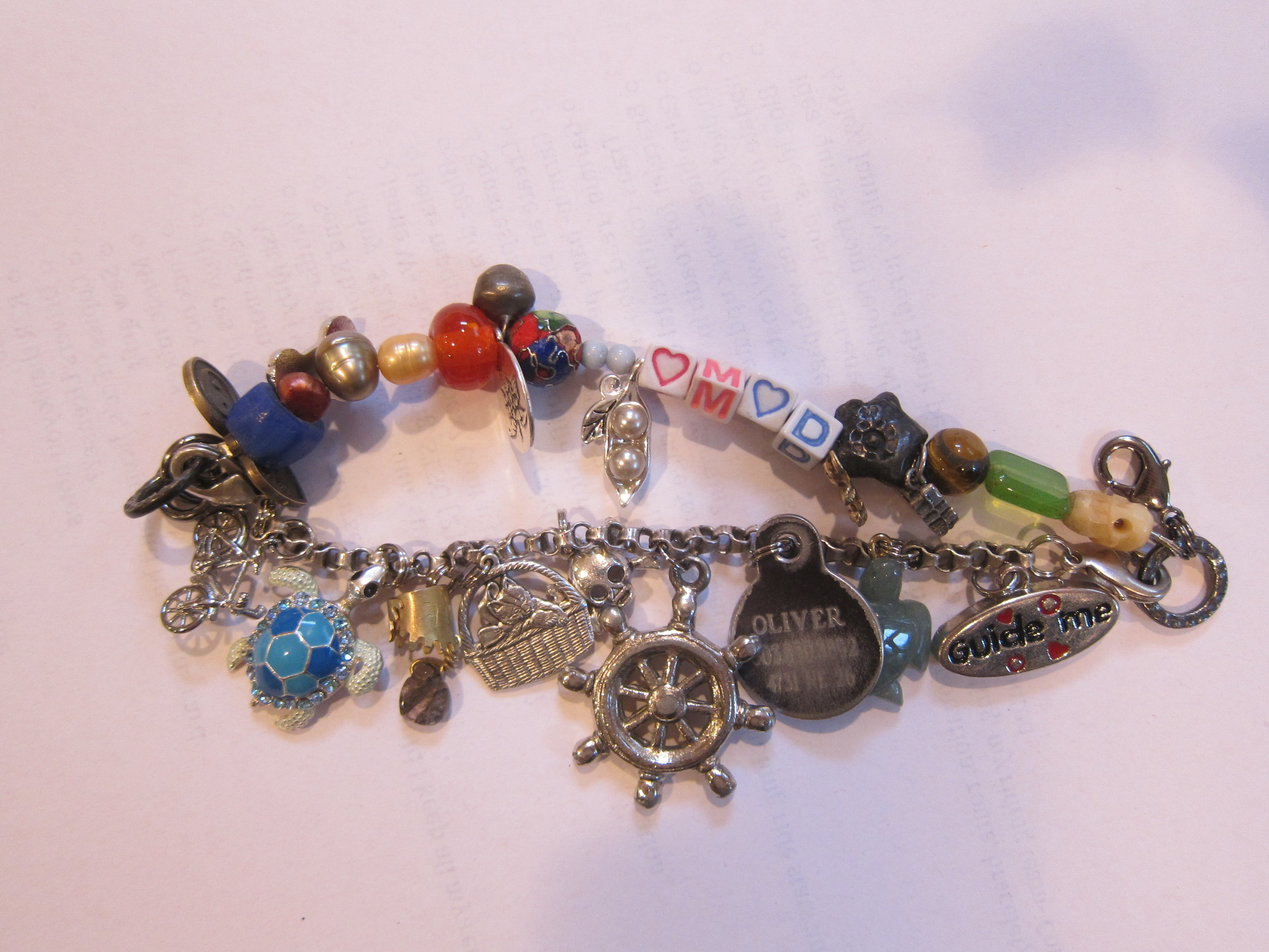 Bracelet made from charms and beads from 21 close friends and family members! Including 2 I purchased for myself.