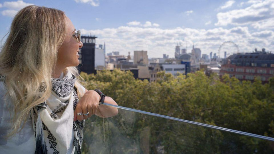 Shelby Knick admiring the panoramic view from Hotel Indigo London on Leicester Square.