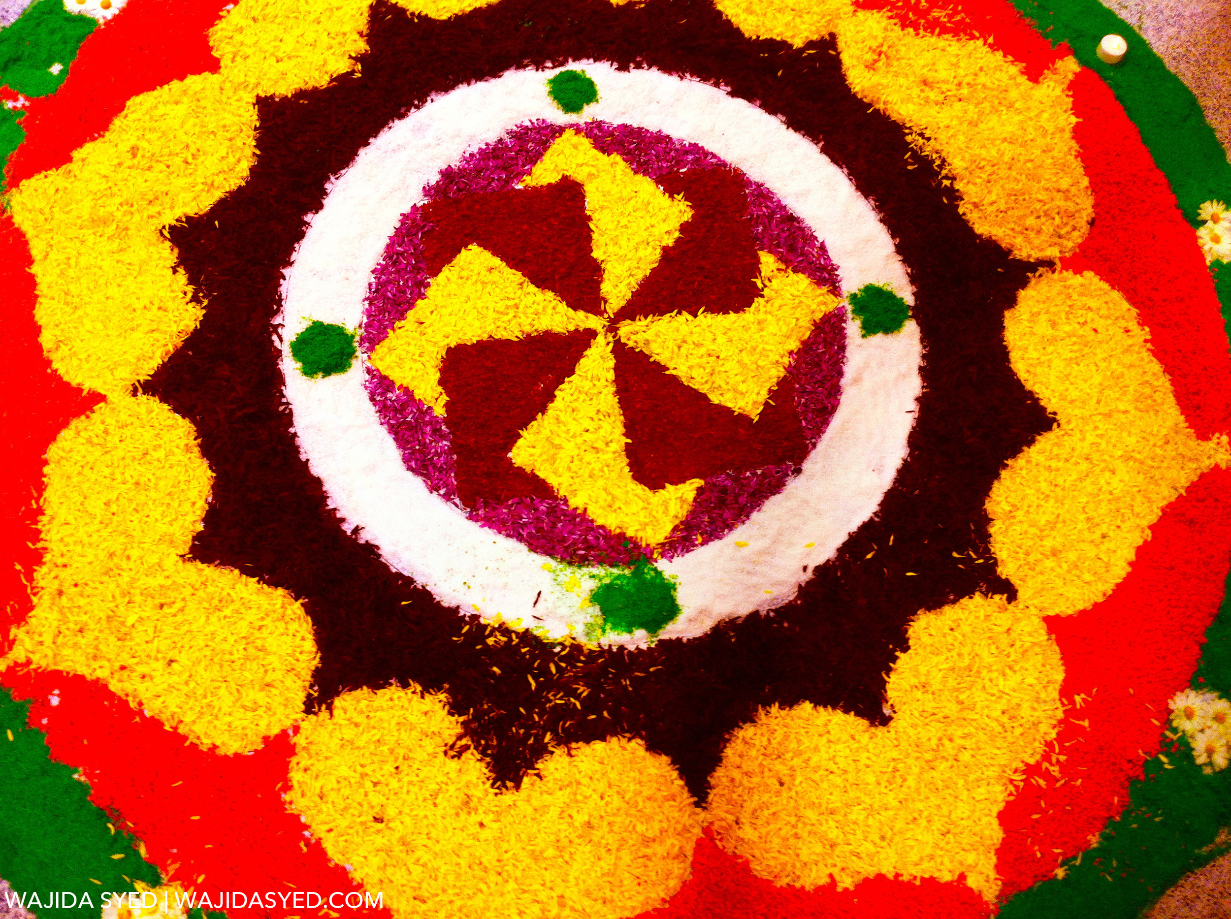 """Rangoli: beautiful artwork made with sand or petals, usually in the shape of a lotus, decorate entrances of homes on Diwali.                                Normal    0                false    false    false       EN-US    JA    AR-SA                                                                                                                                                                                                                                                                                                                                                                                                                                                                                                                                                  /* Style Definitions */ table.MsoNormalTable {mso-style-name:""""Table Normal""""; mso-tstyle-rowband-size:0; mso-tstyle-colband-size:0; mso-style-noshow:yes; mso-style-priority:99; mso-style-parent:""""""""; mso-padding-alt:0in 5.4pt 0in 5.4pt; mso-para-margin:0in; mso-para-margin-bottom:.0001pt; mso-pagination:widow-orphan; font-size:12.0pt; font-family:Cambria; mso-ascii-font-family:Cambria; mso-ascii-theme-font:minor-latin; mso-hansi-font-family:Cambria; mso-hansi-theme-font:minor-latin;}"""