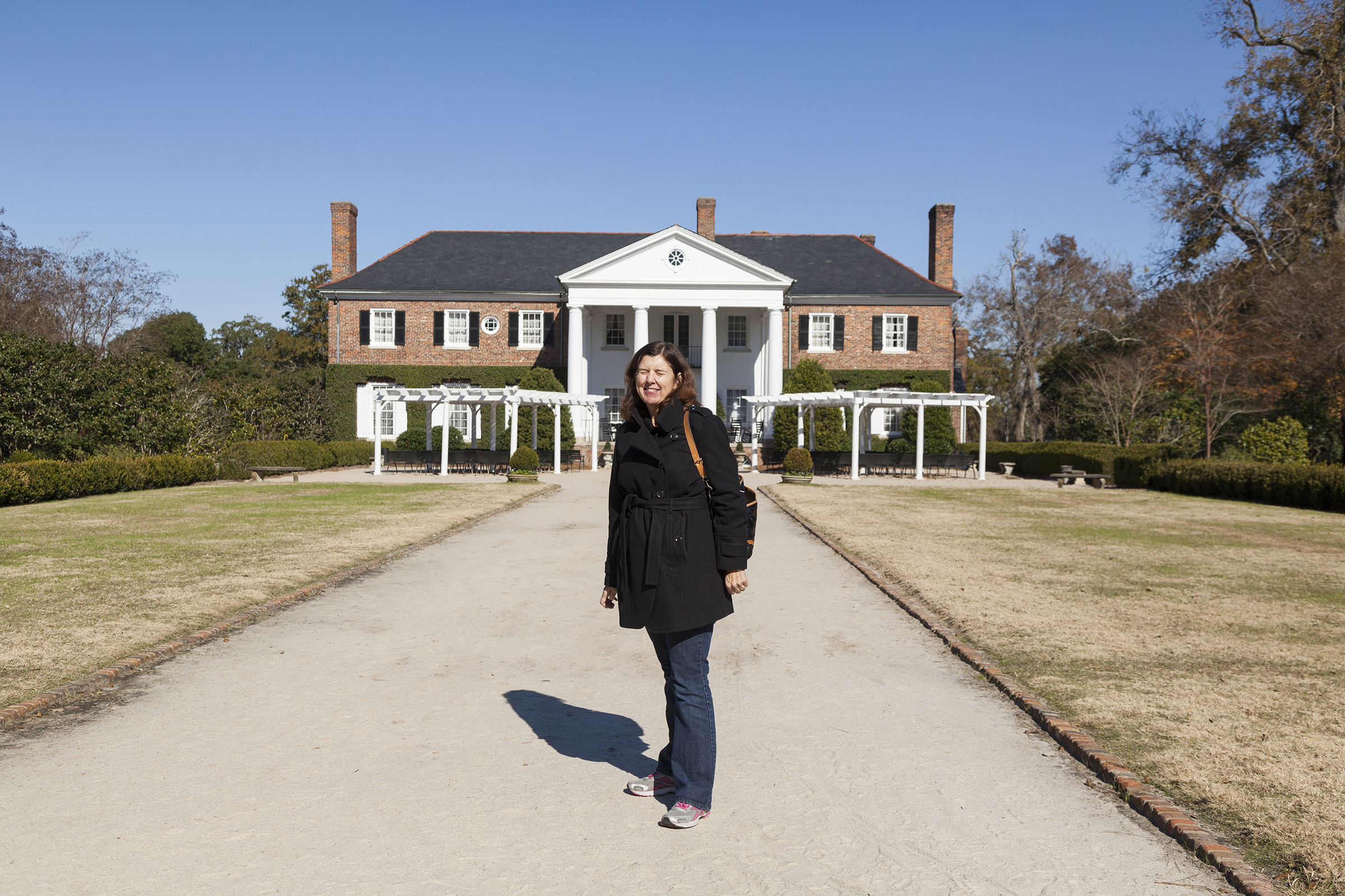Mom with her eyes closed at Boone Hall Plantation, the self-proclaimed most photographed plantation in America