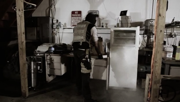 A scavenger searches this box for food. Because fresh pizza is still delivered during the apocalypse.