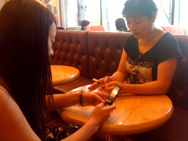 ㅋㅋㅋ my wife and mother in law waiting for their coffee in Tom n Toms doing what all Koreans do well ... Playing with their mobile phones ^^   Sent from my iPhone