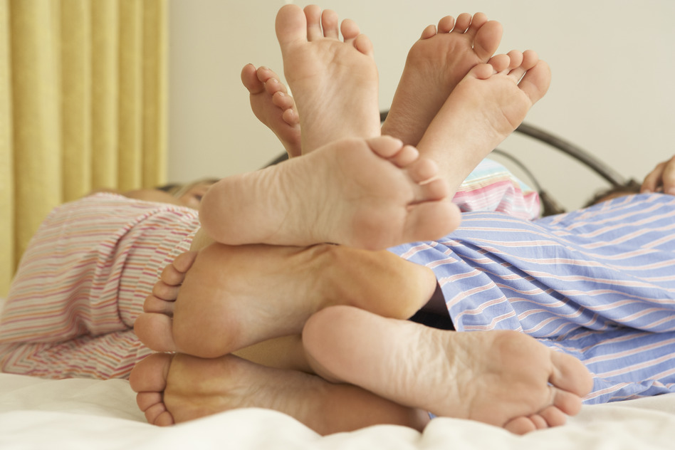 photodune-319147-close-up-of-familys-feet-relaxing-on-bed-at-home-s.jpg