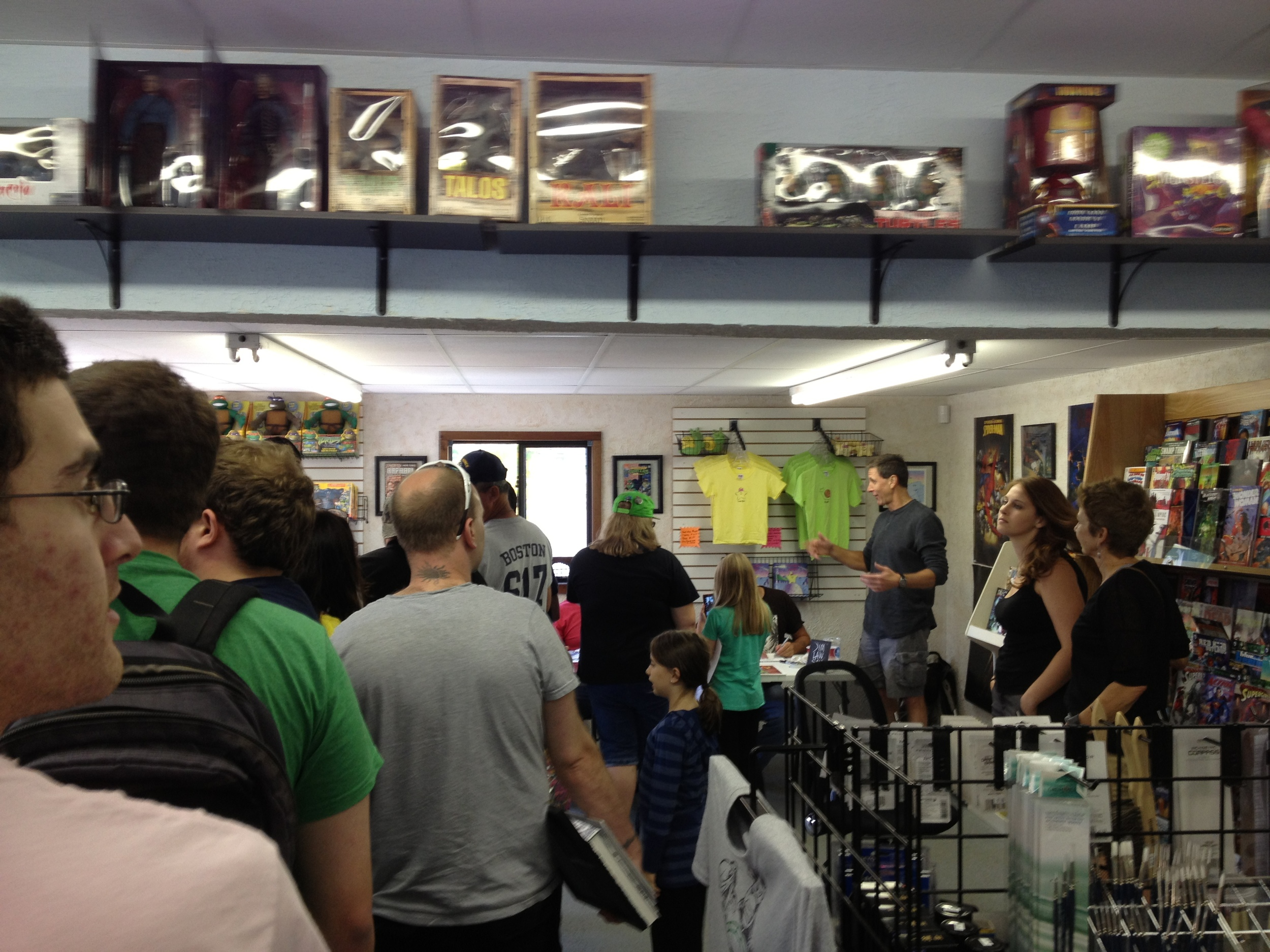Signing line at Shellback Artworks