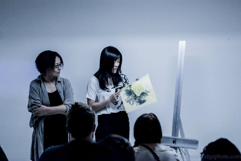 hui He showing her work, with her mother by her side  at the oracle july 2012.