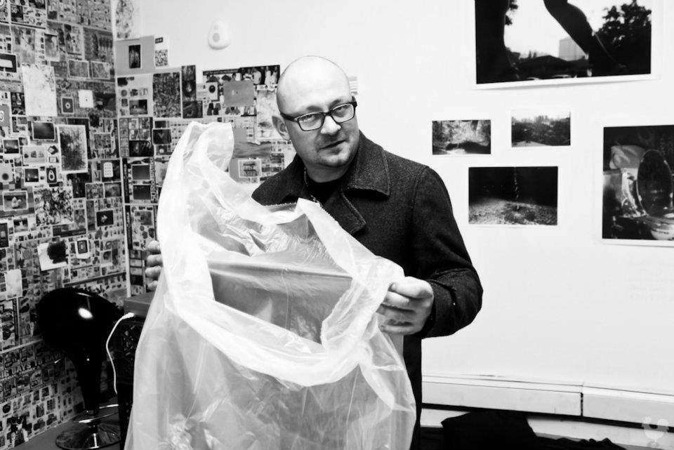 Christian Stolarz ponders if your head will fit in this bag at the  january 2012 gathering at the art pop up shop.