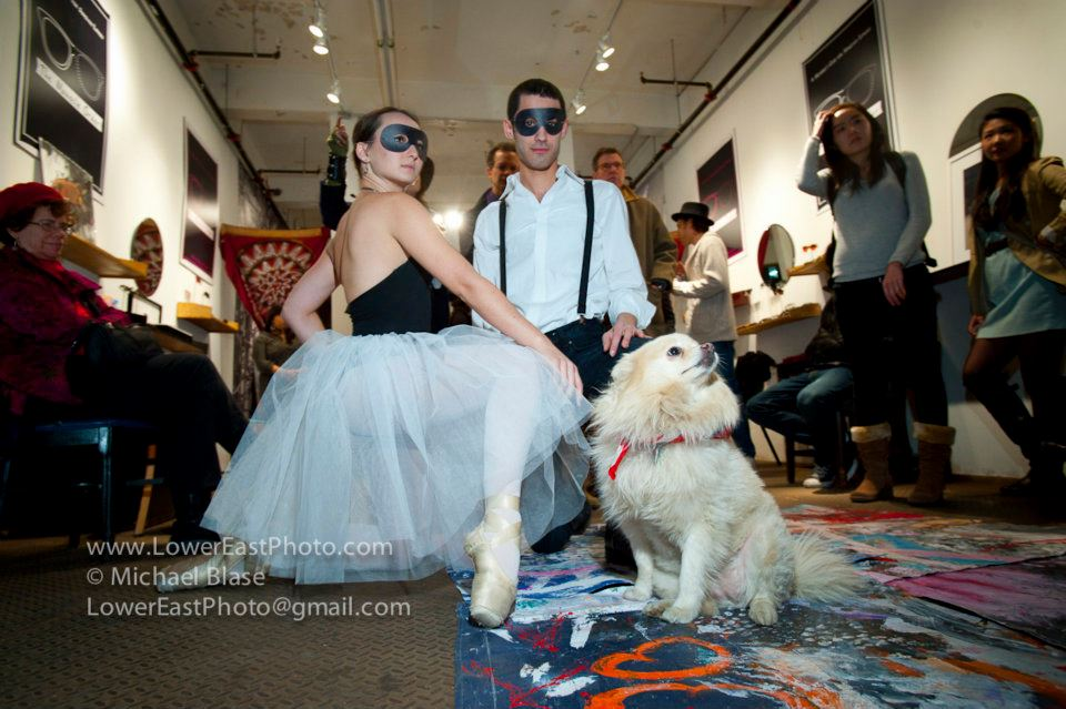 laire Christine Sargenti and Isaac Gut with a cute little puppy at the December 2011 animamus art salon gathering at the monocle order.