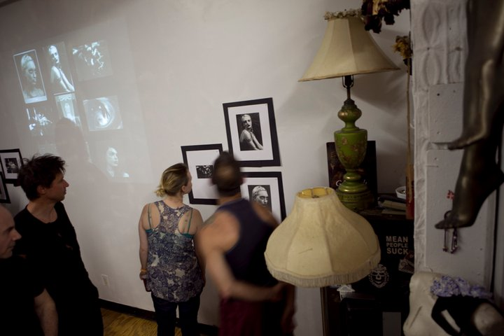 ooking at some of Mara Taber's photographs at ventiko's during june 2011 gathering.