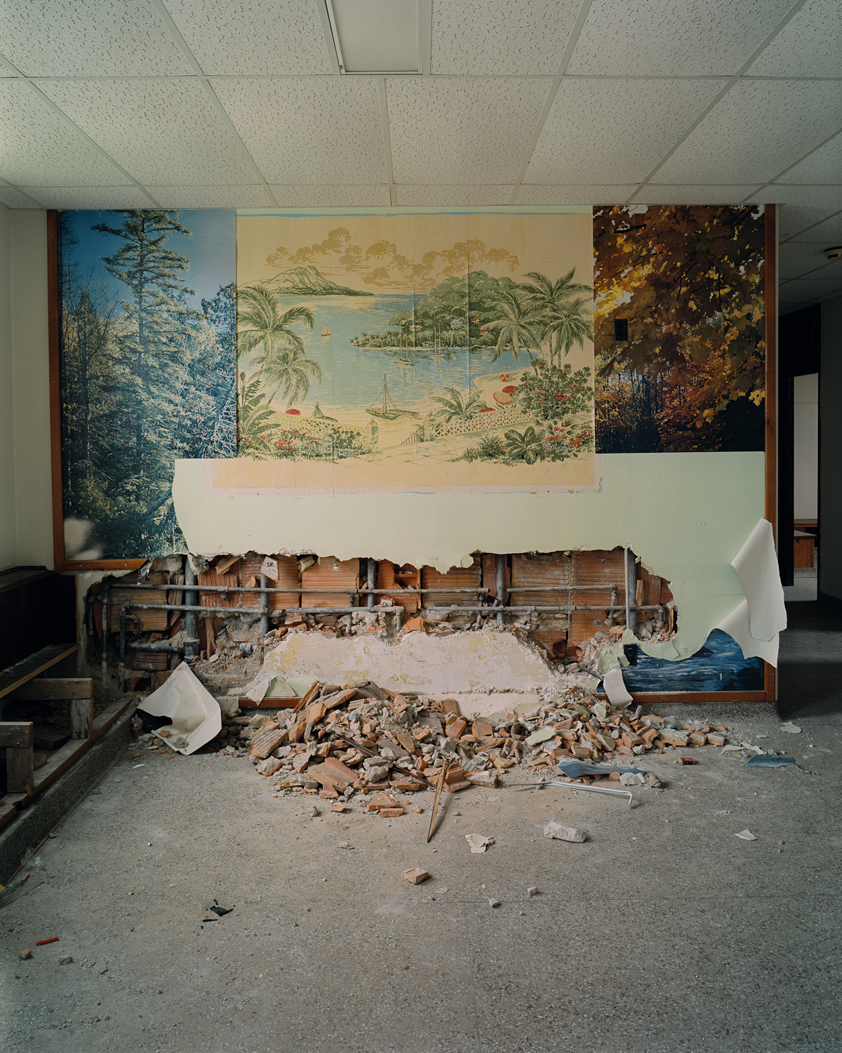 Peeled murals and debris in dayroom, Cottage 4.