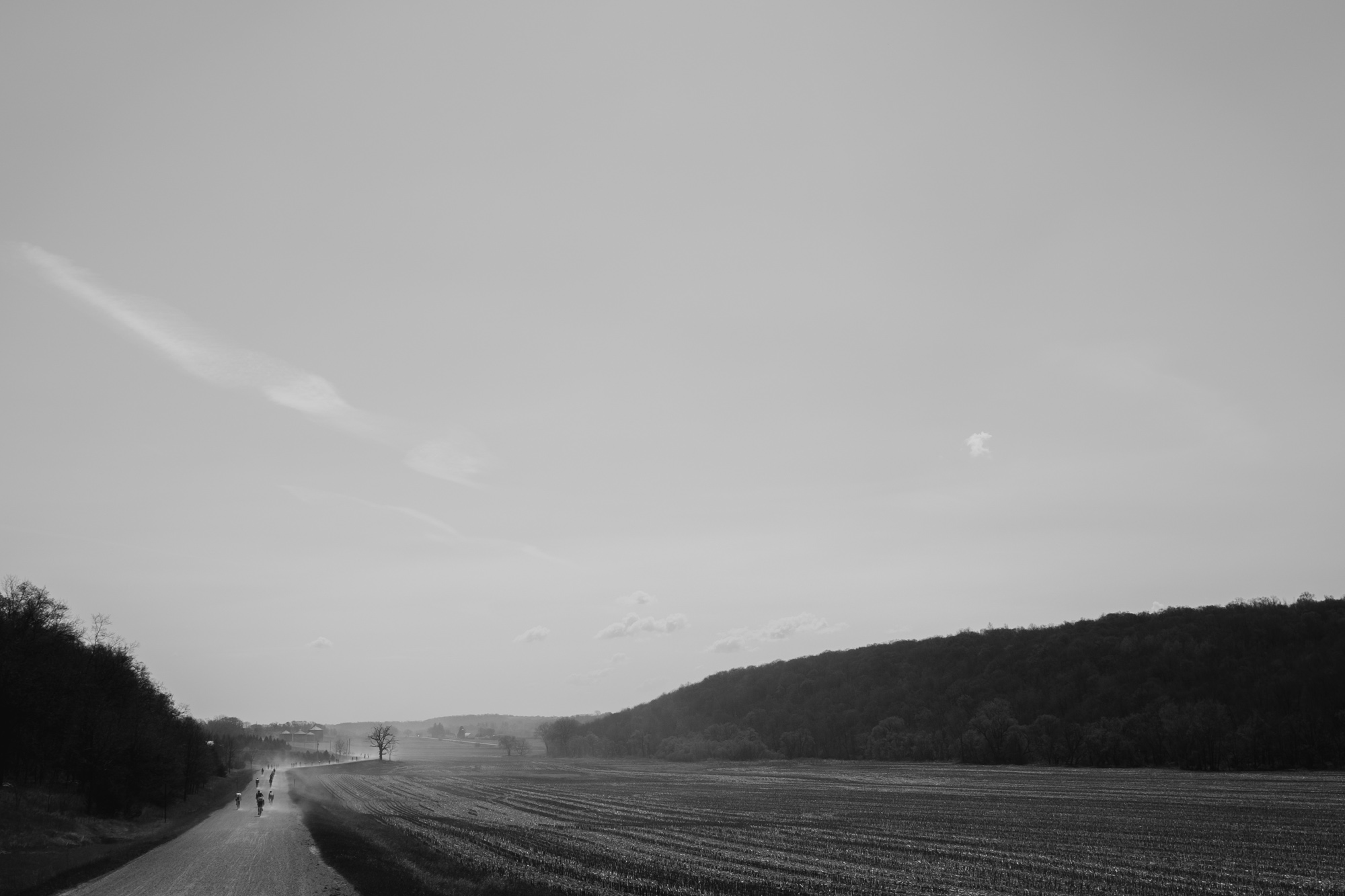 Racers kicked up clouds of dust on the dry roads that stretched into the distance in both directions.