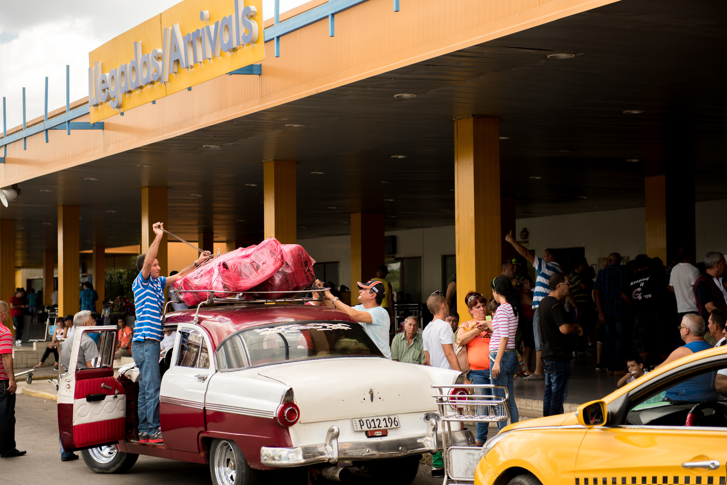 Heat, humidity, and old cars greeted the orchestra members as they arrived in Cuba.