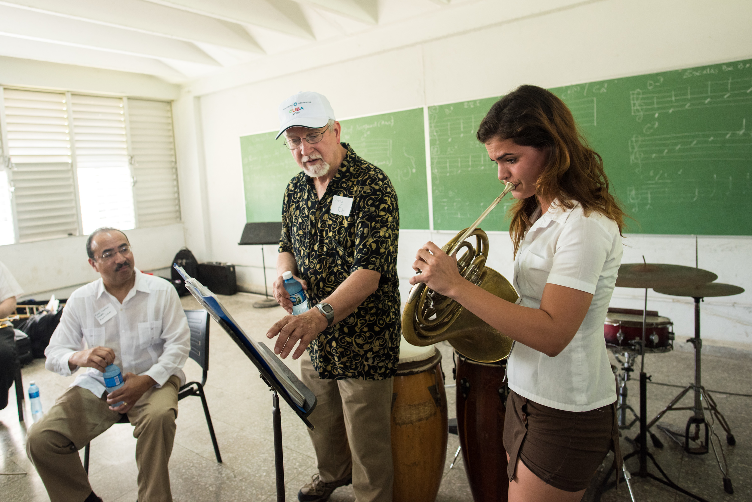 French horn player Herb Winslow worked with a student at the Escuela Nacional de Arte during a master class on Thursday, where trumpeter Manny Laureano translated