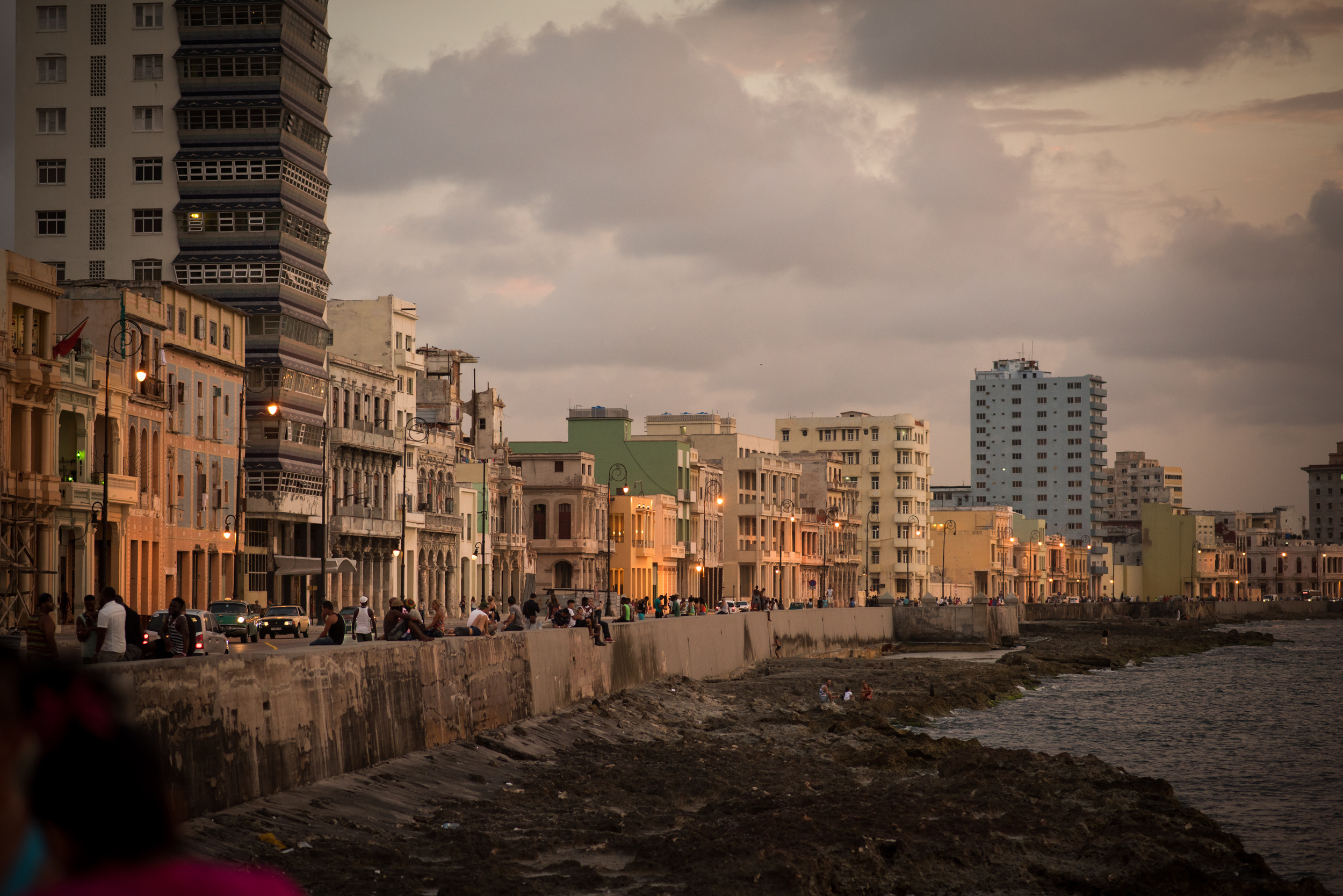 Dusk on the Malecon, the roadway and seawall along the bay that is a gathering place for Cubans and tourists alike