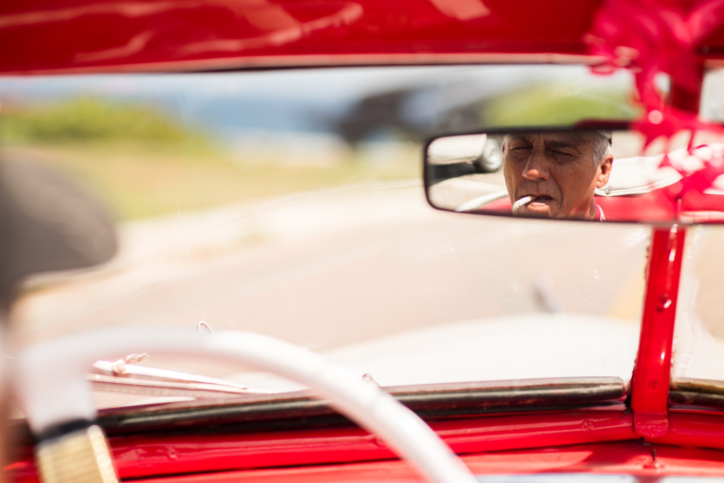 The owner of a 1948 DeSoto convertible, passed down fromhis father from his grandfather, makes a living driving tourists around Havana in his classic car.