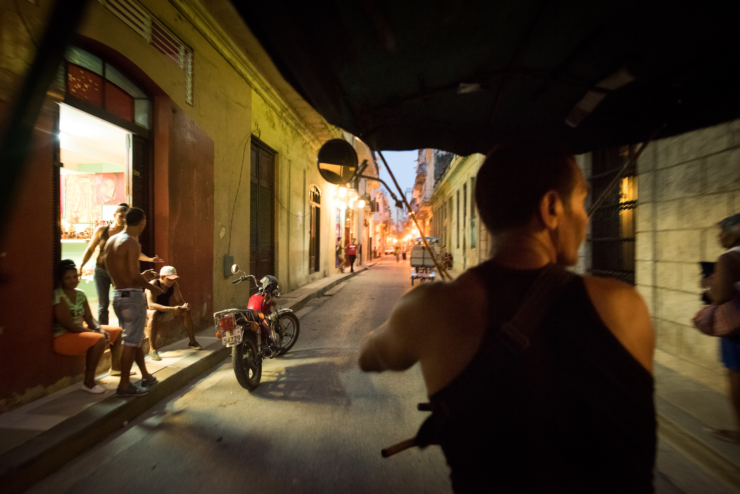Riding through the streets of Old Havana in the back of a pedicab.