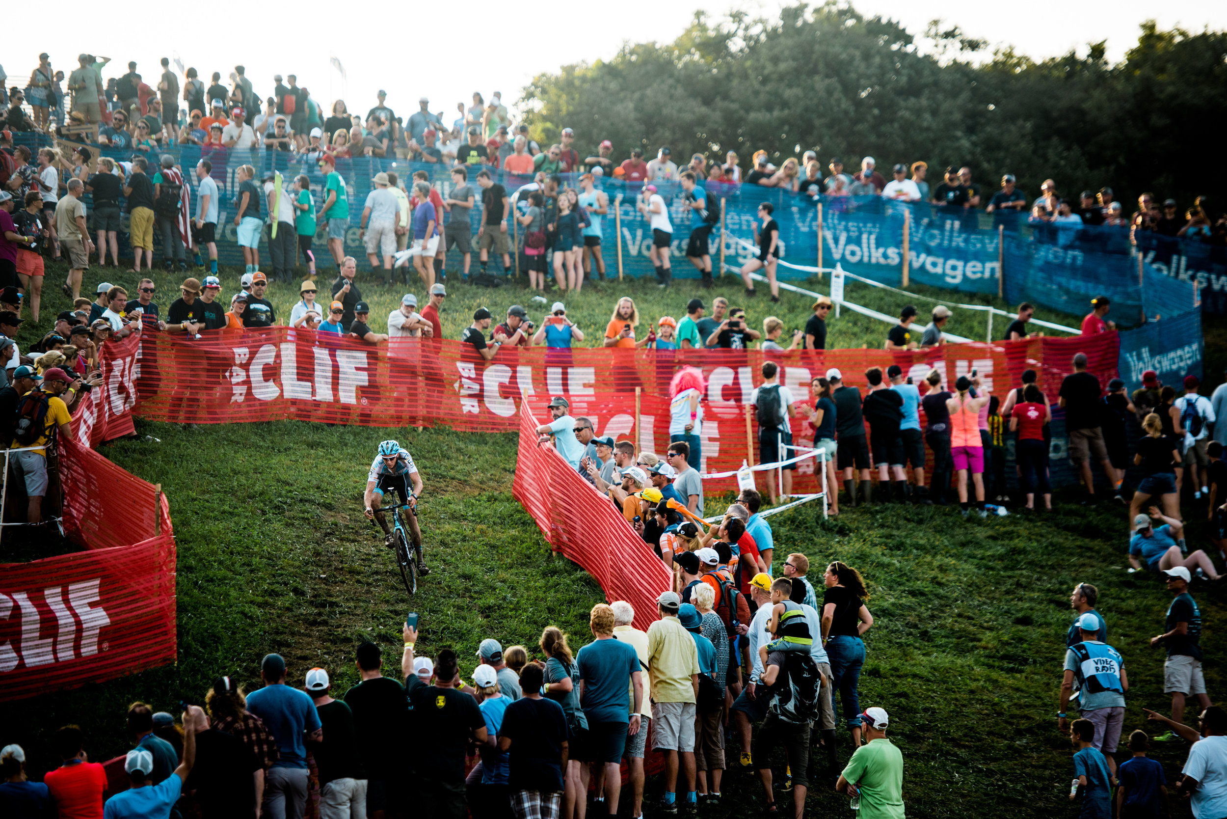 Crowds line the course as riders make their way back down through switchbacks from the top of Mt Krumit.
