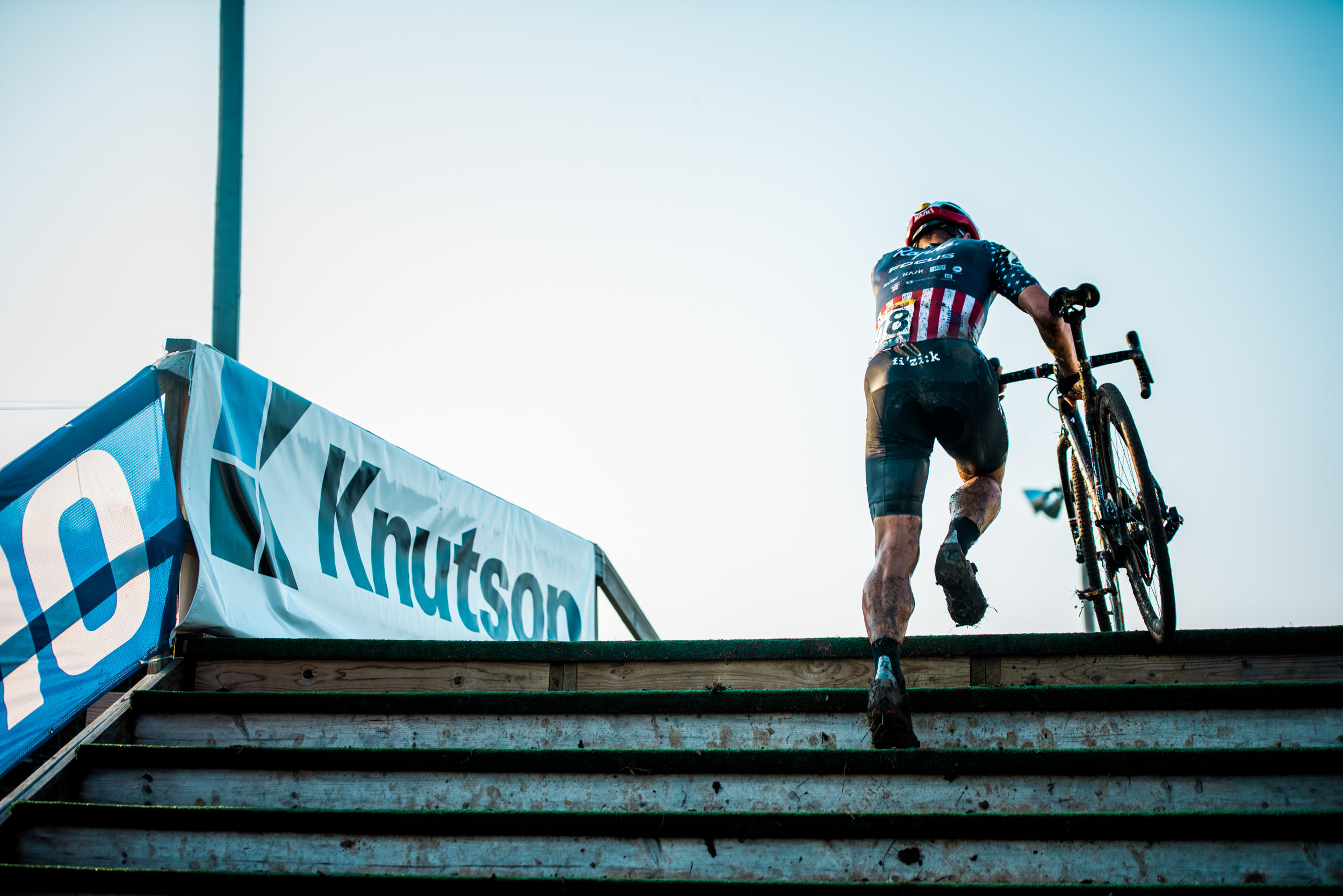 US National Cyclocross chamption Jeremy Powers finishes climbing the stairs of the fly-over obstacle.