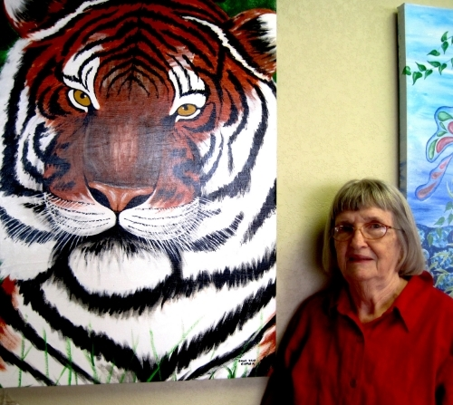Donna Jean Carver pictured next to her work at the Family Medical Center.