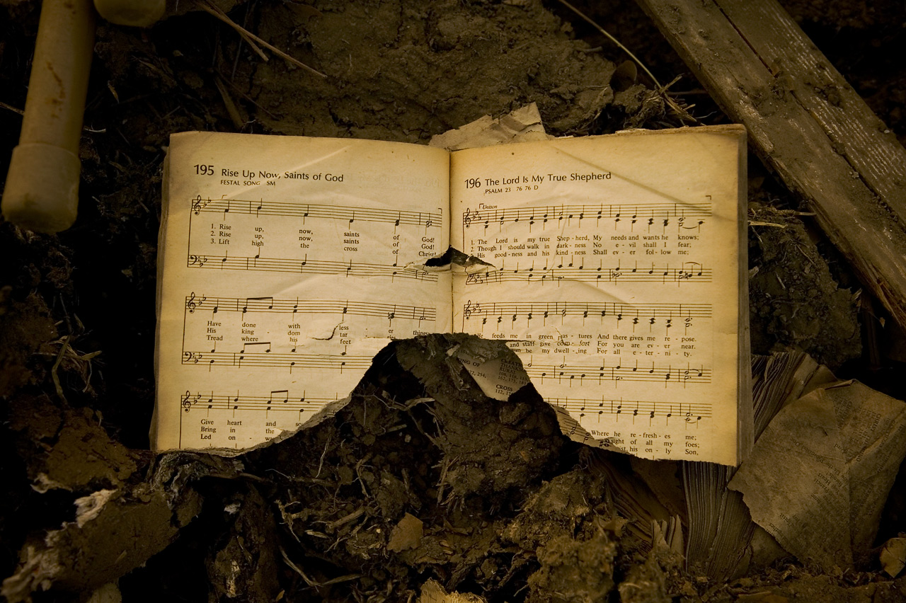 Hymnal, photographed as it rested in the rubble of the Catholic church, Pearlington, Missippi