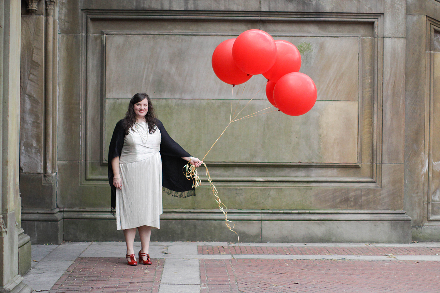 Central Park styled birthday session with big balloons.