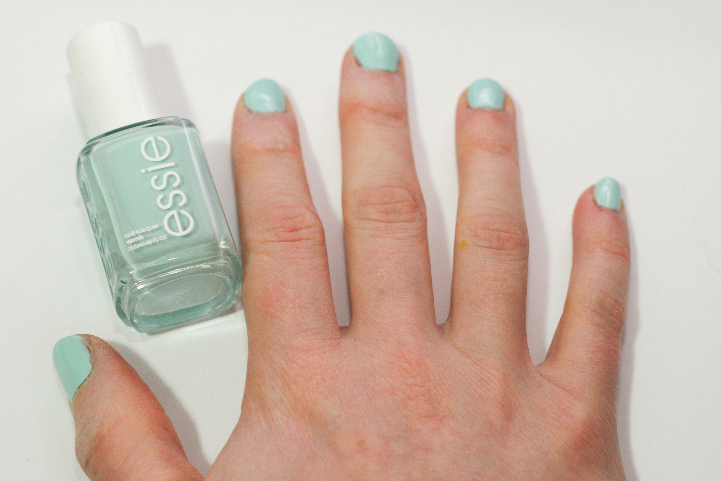 Two coats of Essie's Mint Candy Apple nail polish with clear OPI base coat and top coat.