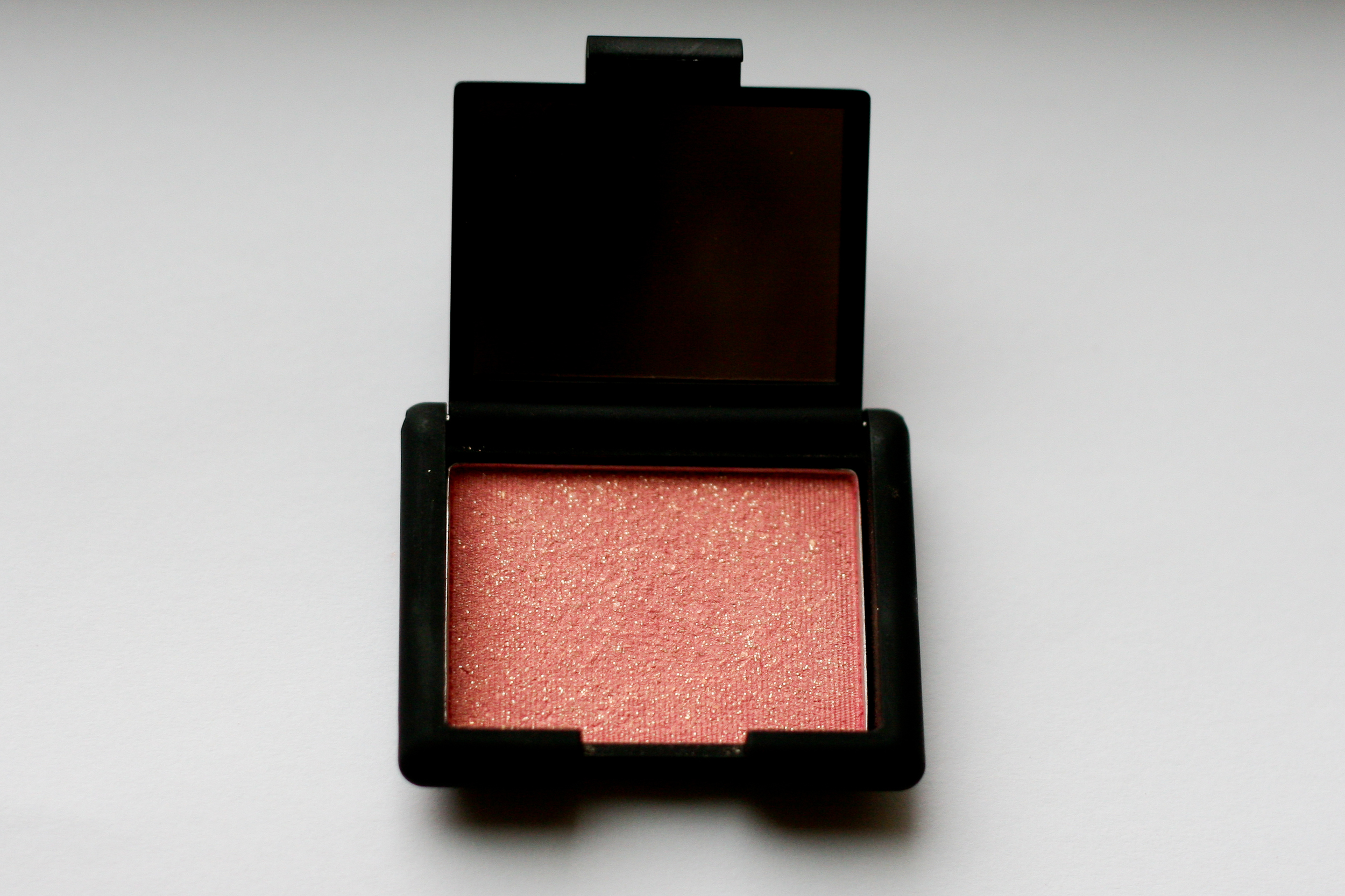 NARS Super Orgasm blush. It's hard to see in this photo, but the compact does include a mirror.