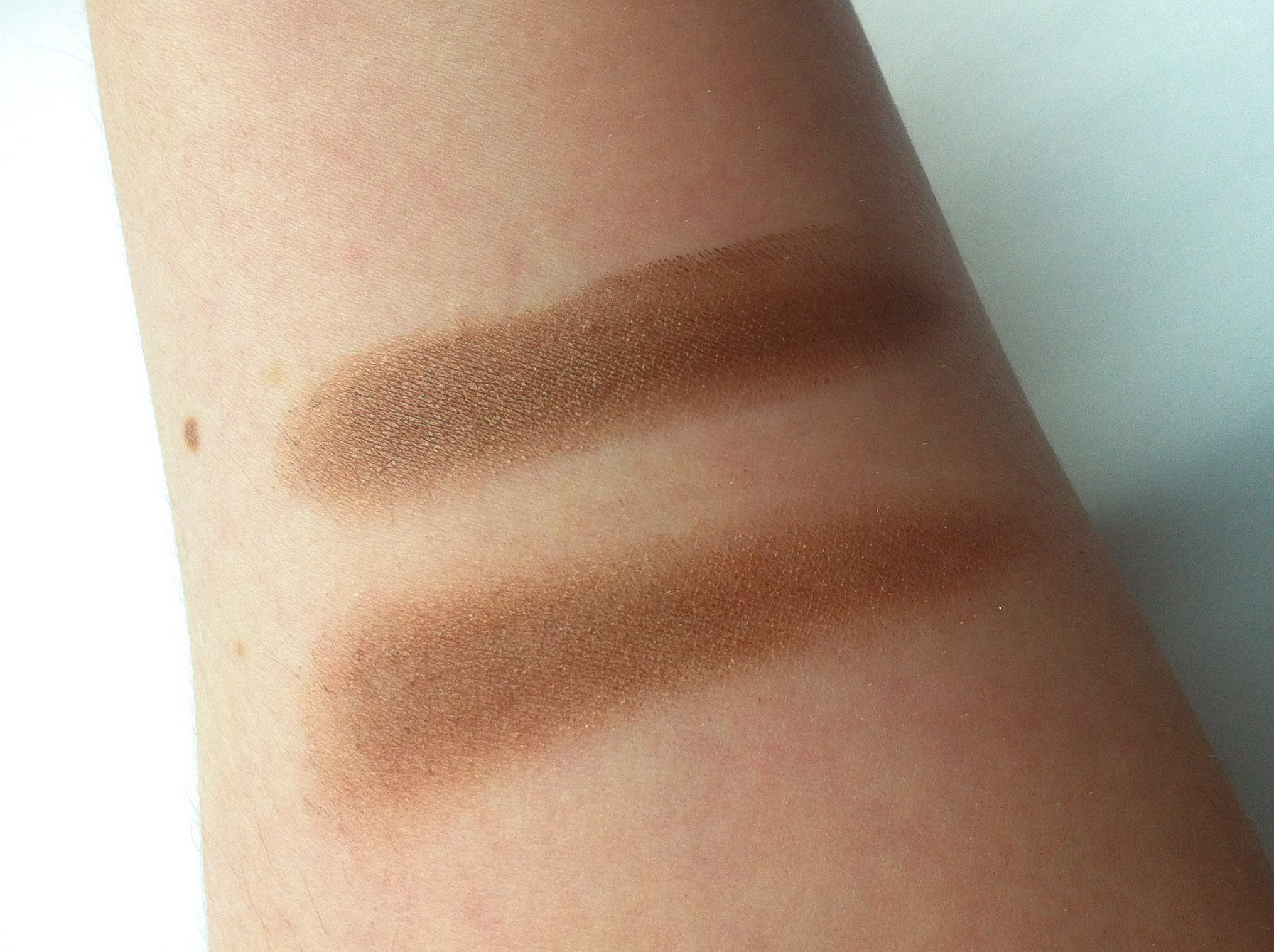 I swatched MAC Eclair (Paint Pot) next to MAC Mulch (powder eyeshadow) for reference. Eclair is on top, and Mulch is on the bottom.